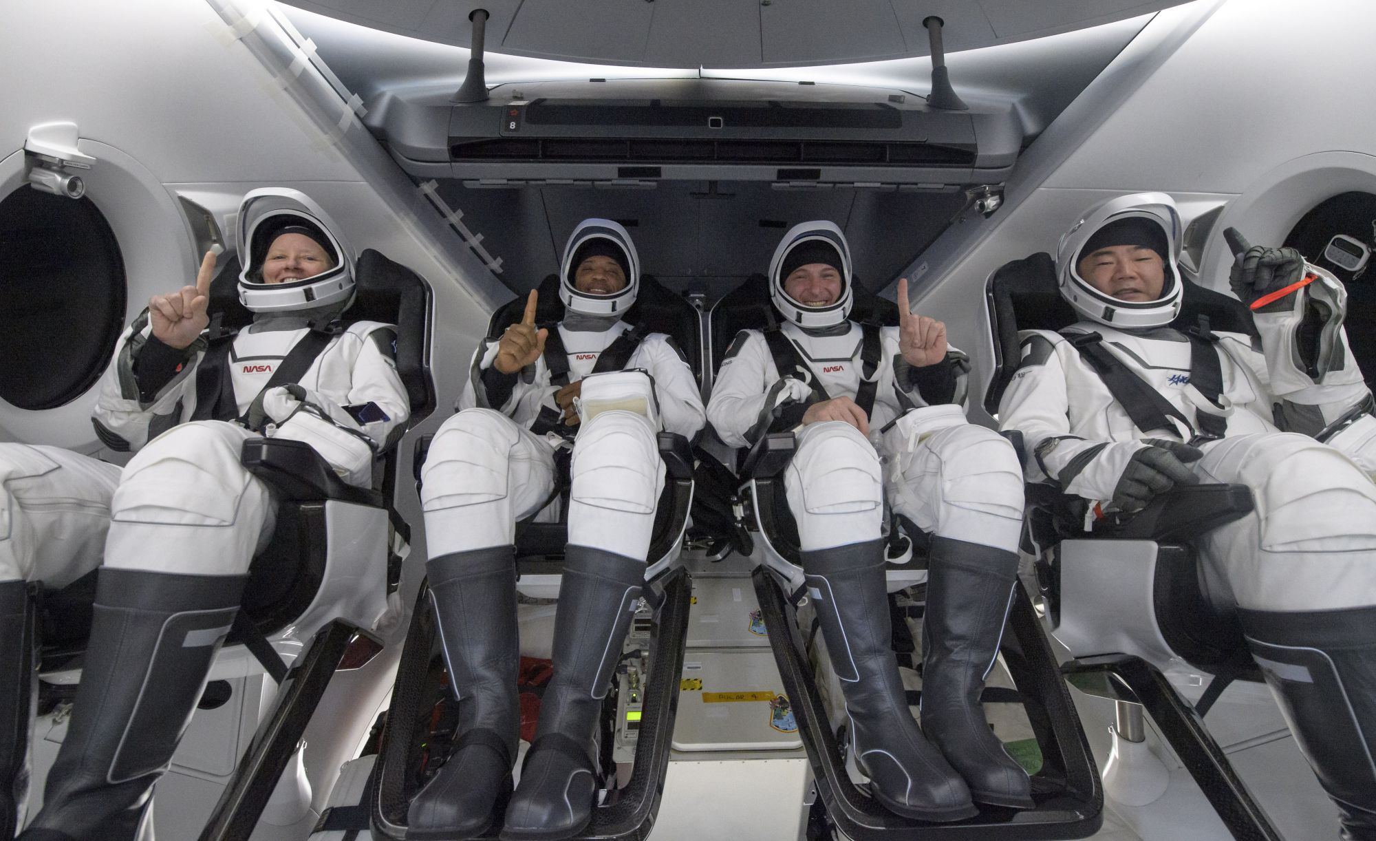 NASA astronauts Shannon Walker, left, Victor Glover, Mike Hopkins, and Japan Aerospace Exploration Agency (JAXA) astronaut Soichi Noguchi, right are seen inside the SpaceX Crew Dragon Resilience spacecraft onboard the SpaceX GO Navigator recovery ship shortly after having landed in the Gulf of Mexico off the coast of Panama City, Florida, Sunday, May 2, 2021. | Photo: NASA / Bill Ingalls