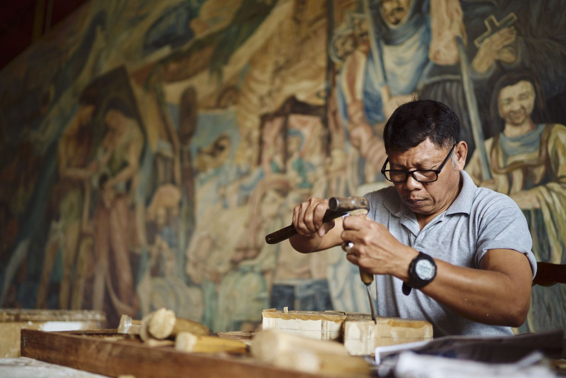 53-year-old Arnold Flores has been working as a sculptor in Las Casas Filipinas de Acuzar for four years, creating intricate hand-carved wood and styro pieces
