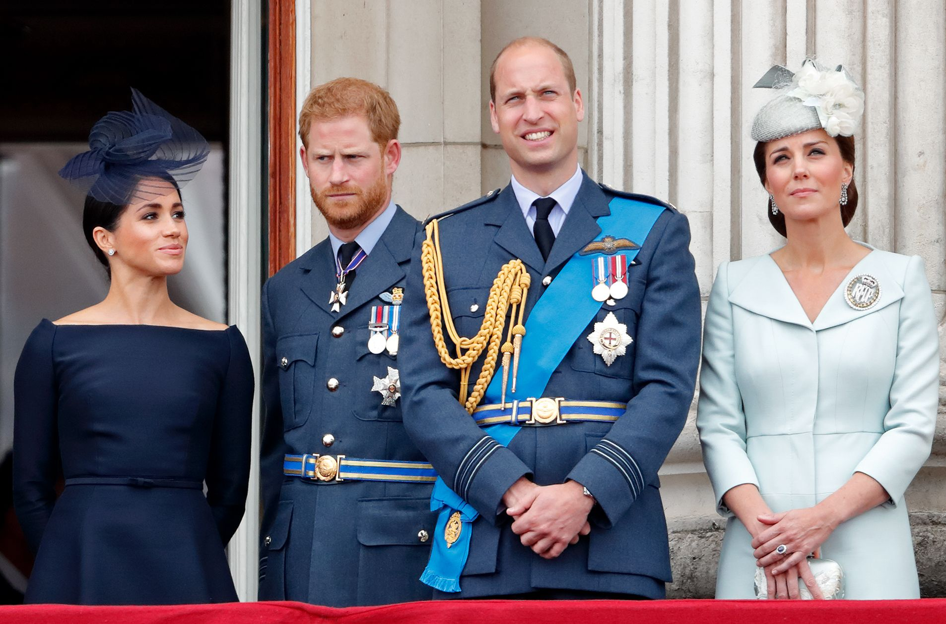 LONDON, UNITED KINGDOM - JULY 10: (EMBARGOED FOR PUBLICATION IN UK NEWSPAPERS UNTIL 24 HOURS AFTER CREATE DATE AND TIME) Meghan, Duchess of Sussex, Prince Harry, Duke of Sussex, Prince William, Duke of Cambridge and Catherine, Duchess of Cambridge watch a flypast to mark the centenary of the Royal Air Force from the balcony of Buckingham Palace on July 10, 2018 in London, England. The 100th birthday of the RAF, which was founded on on 1 April 1918, was marked with a centenary parade with the presentation of