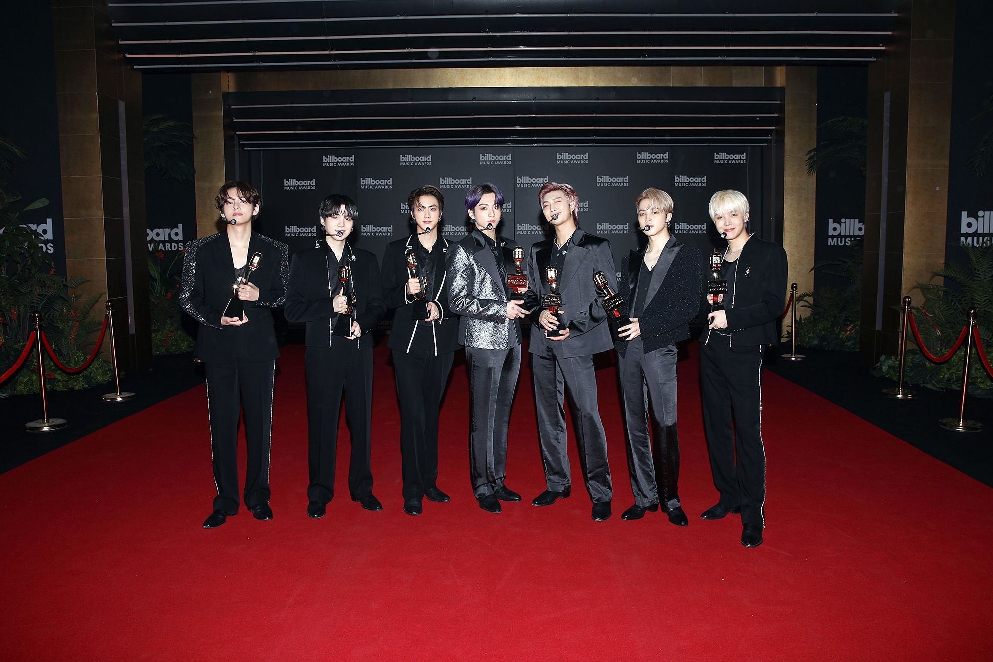 (L-R) In this image released on May 23, V, Suga, Jin, Jungkook, RM, Jimin, and J-Hope of BTS, winners of the Top Selling Song Award for 'Dynamite,' pose for the 2021 Billboard Music Awards, broadcast on May 23, 2021 at Microsoft Theater in Los Angeles, California. (Photo by Billboard Music Awards 2021 via Getty Images)