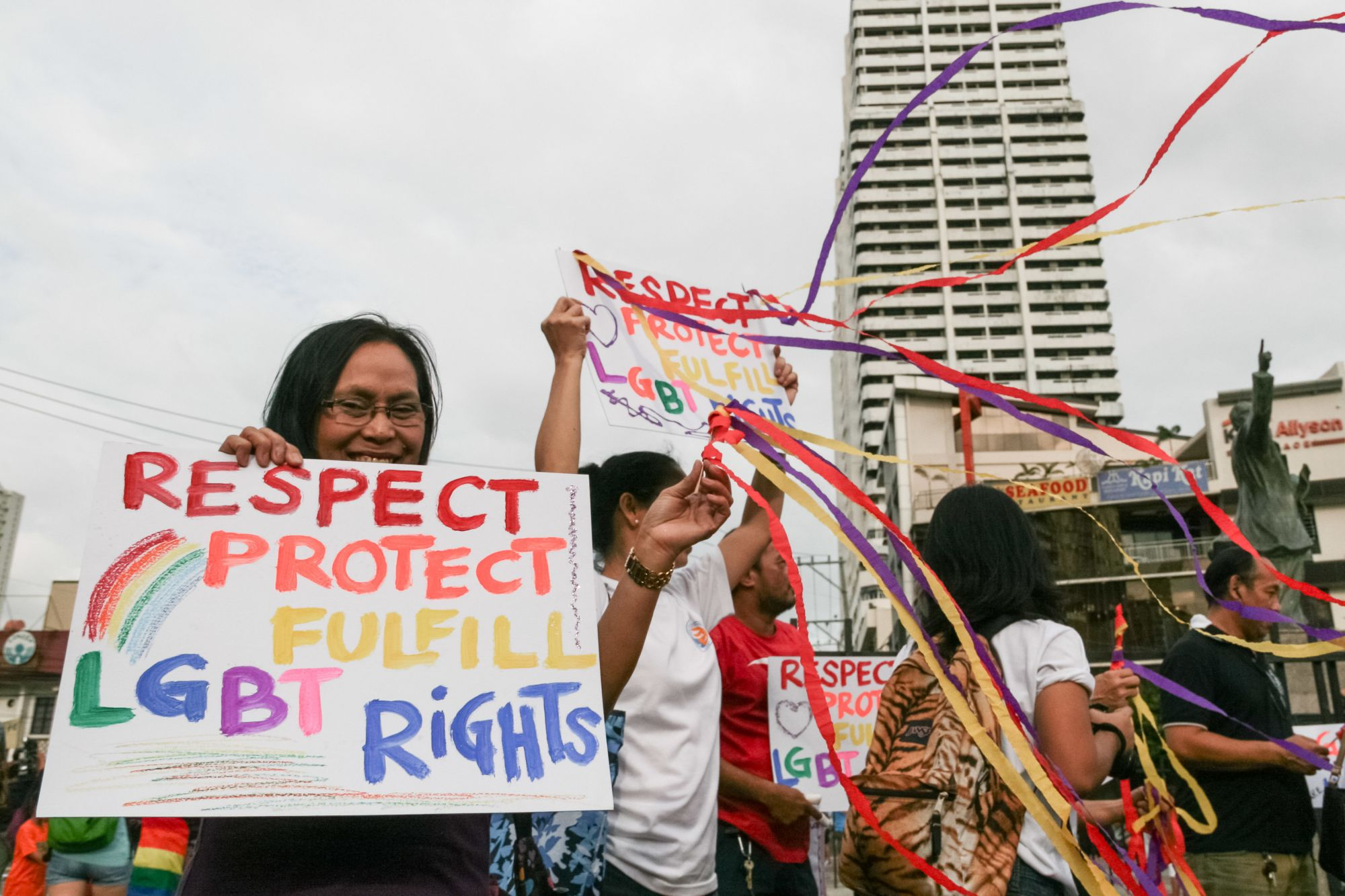 Gay Pride attendees display posters asking for equal rights for the LGBT community at the Remedios Circle in Manila. -- Dubbed as the longest running Gay Pride Parade in Asia, the 2013 Manila Pride march was attended by different LGBT groups asking for equal rights and the passage of the Anti-Discrimination Bill. Photo: J Gerard Seguia/NurPhoto (Photo by NurPhoto/Corbis via Getty Images)