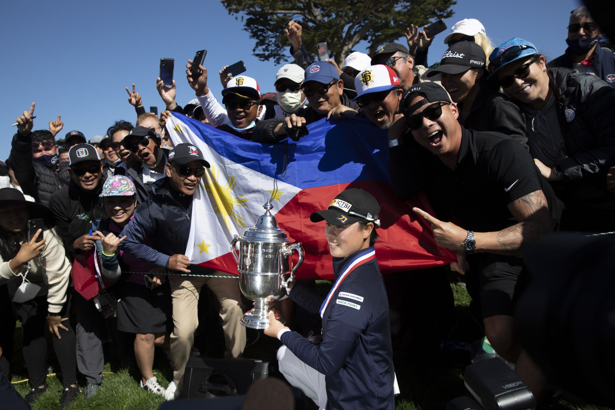 SAN FRANCISCO, CA - JUNE 06: Yuka Saso of the Philippines celebrates with the Harton S. Semple Trophy after winning the 76th U.S. Women's Open Championship held on the Lake Course at the Olympic Club in San Francisco, Calif. on Sunday, June 6, 2021. (Santiago Mejia/The San Francisco Chronicle via Getty Images) Saso won following a three-hole playoff against Nasa Hataoka of Japan.