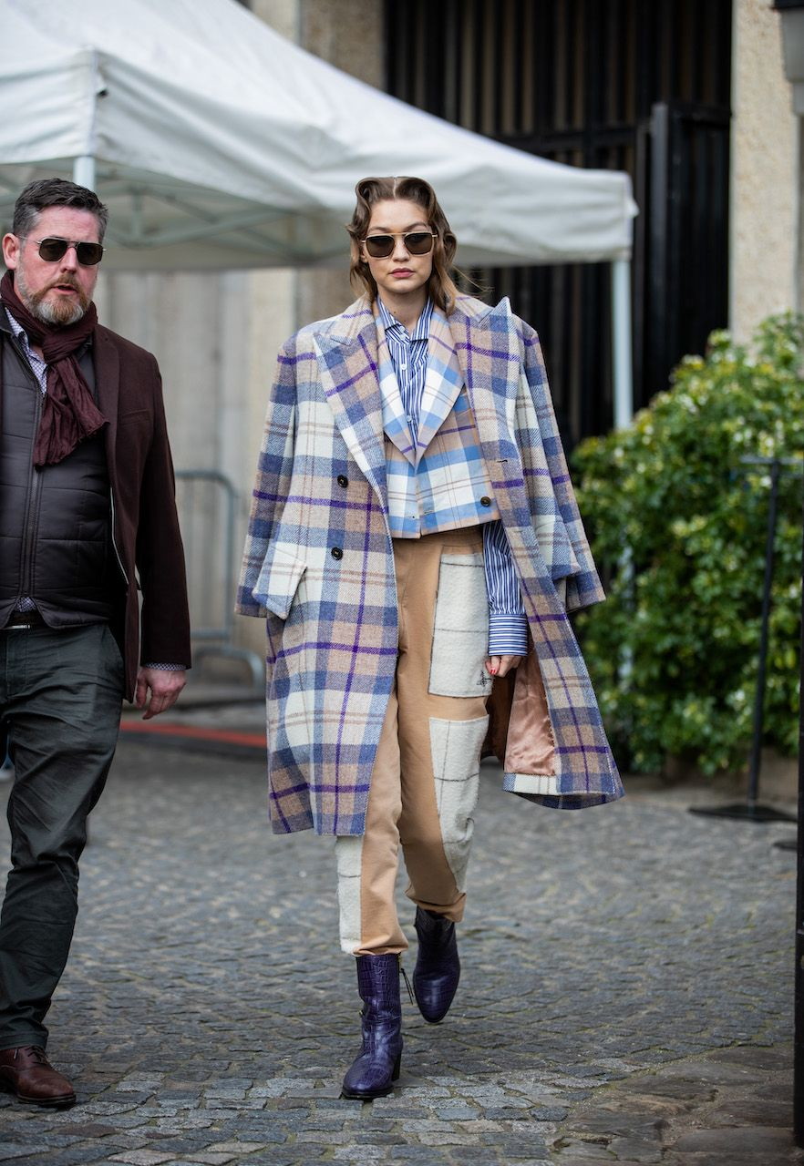 PARIS, FRANCE - MARCH 03: Gigi Hadid is seen wearing checkered coat and cropped blazer, camel two tone pants, striped button shirt outside Miu Miu during Paris Fashion Week Womenswear Fall/Winter 2020/2021 : Day Nine on March 03, 2020 in Paris, France. (Photo by Christian Vierig/GC Images)