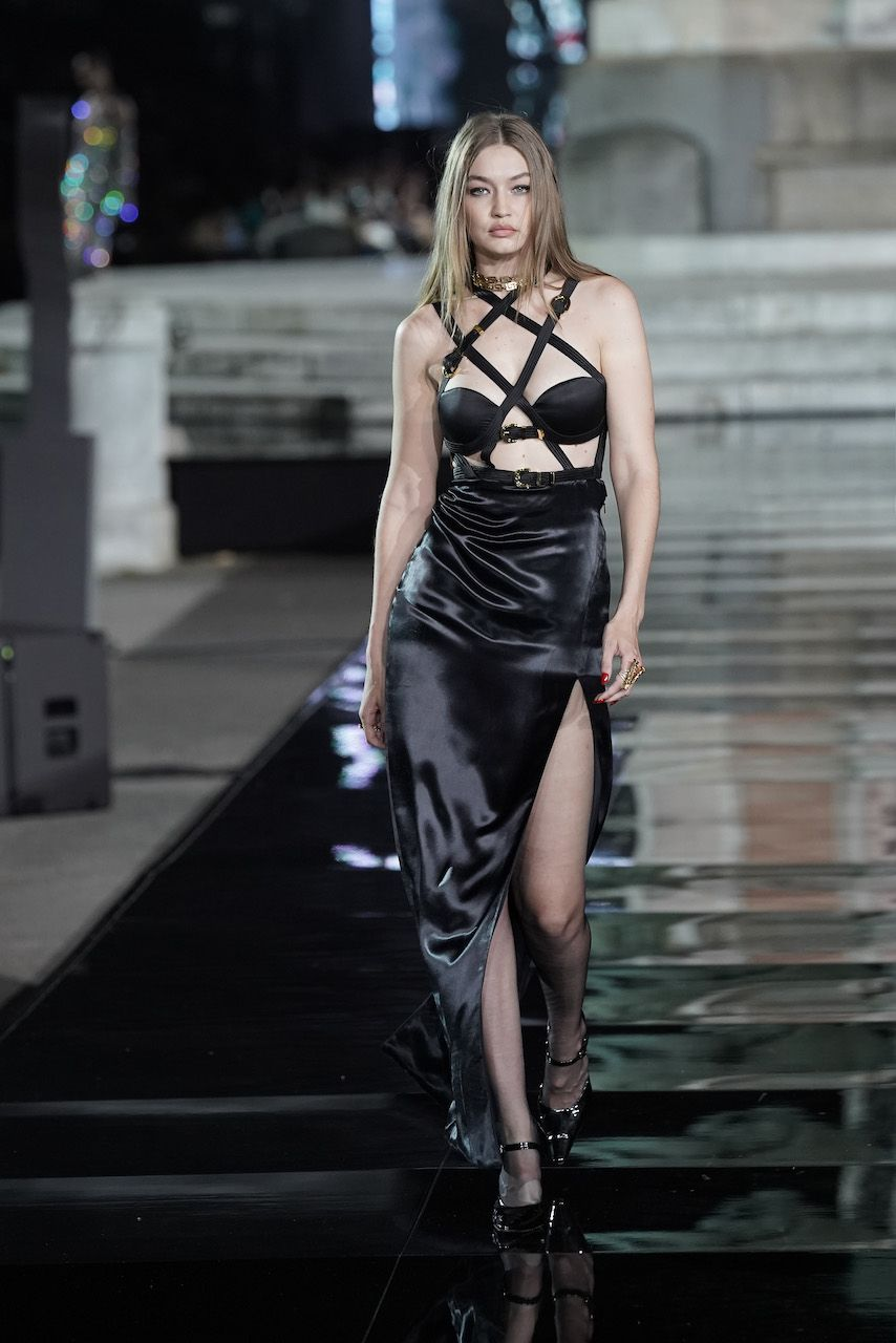 FLORENCE, ITALY - JUNE 13: Gigi Hadid walks the runway, wearing Versace, at the CR runway x LUISAVIAROMA 90th Anniversary Show during Pitti Immagine Uomo 96 on June 13, 2019 in Florence, Italy. (Photo by Vittorio Zunino Celotto/Getty Images for LuisaViaRoma)