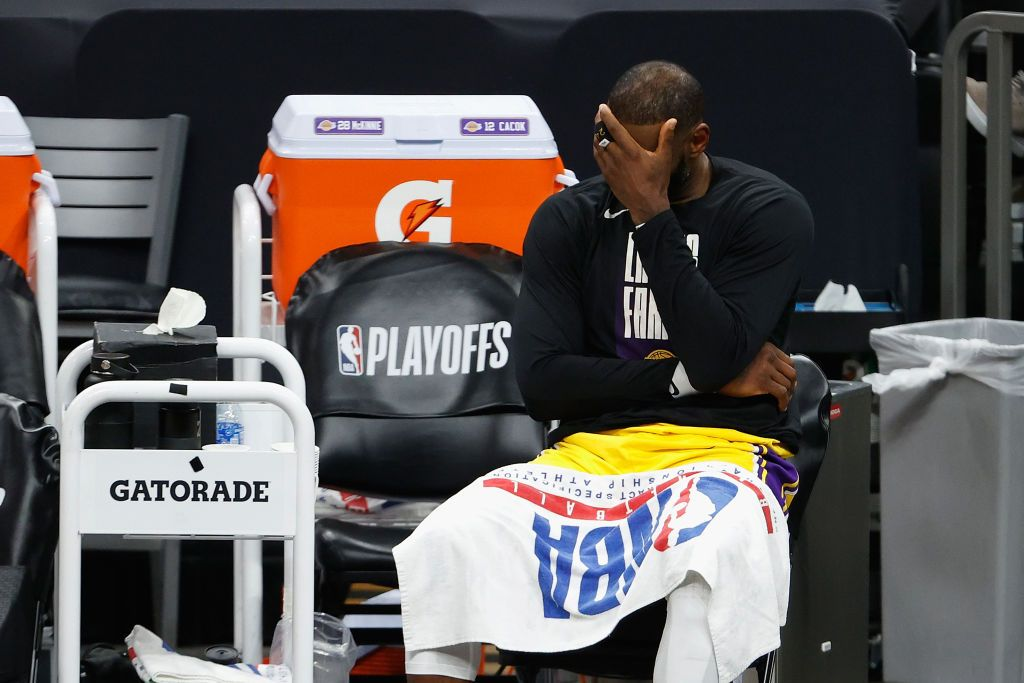 PHOENIX, ARIZONA - JUNE 01:  LeBron James #23 of the Los Angeles Lakers reacts on the bench during the second half in Game Five of the Western Conference first-round playoff series at Phoenix Suns Arena on June 01, 2021 in Phoenix, Arizona. NOTE TO USER: User expressly acknowledges and agrees that, by downloading and or using this photograph, User is consenting to the terms and conditions of the Getty Images License Agreement.  (Photo by Christian Petersen/Getty Images)