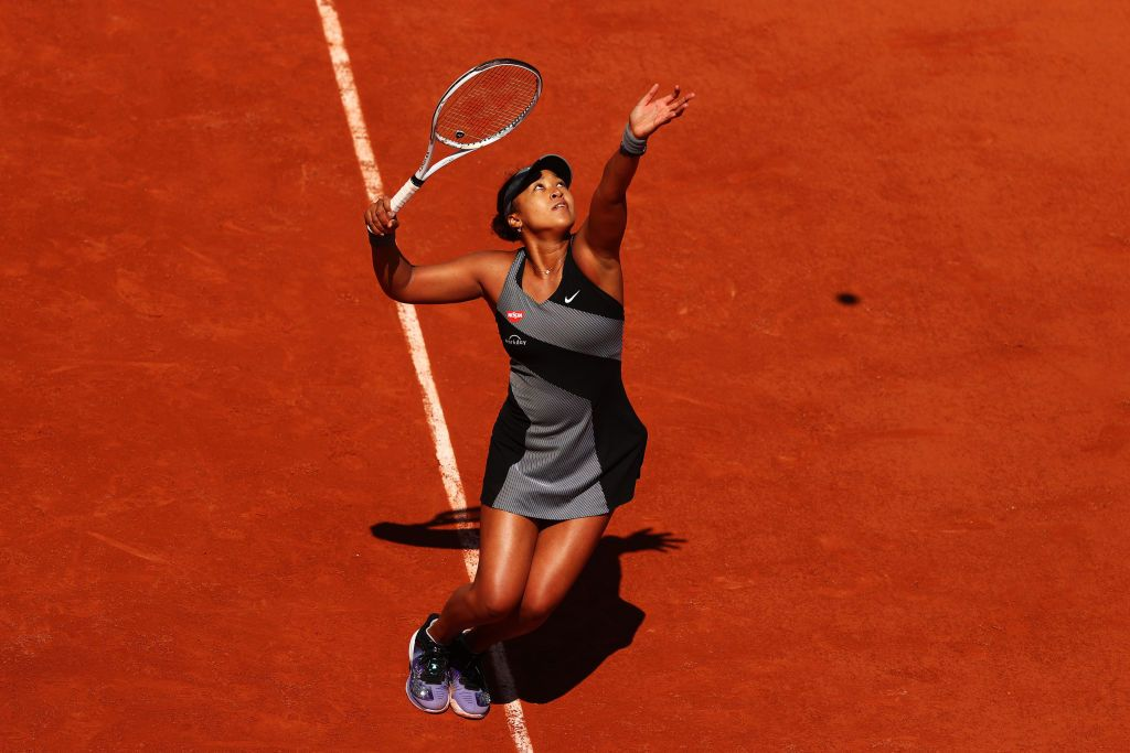 PARIS, FRANCE - MAY 30: Naomi Osaka of Japan serves in her First Round match against Patricia Maria Tig of Romania during Day One of the 2021 French Open at Roland Garros on May 30, 2021 in Paris, France. (Photo by Julian Finney/Getty Images)