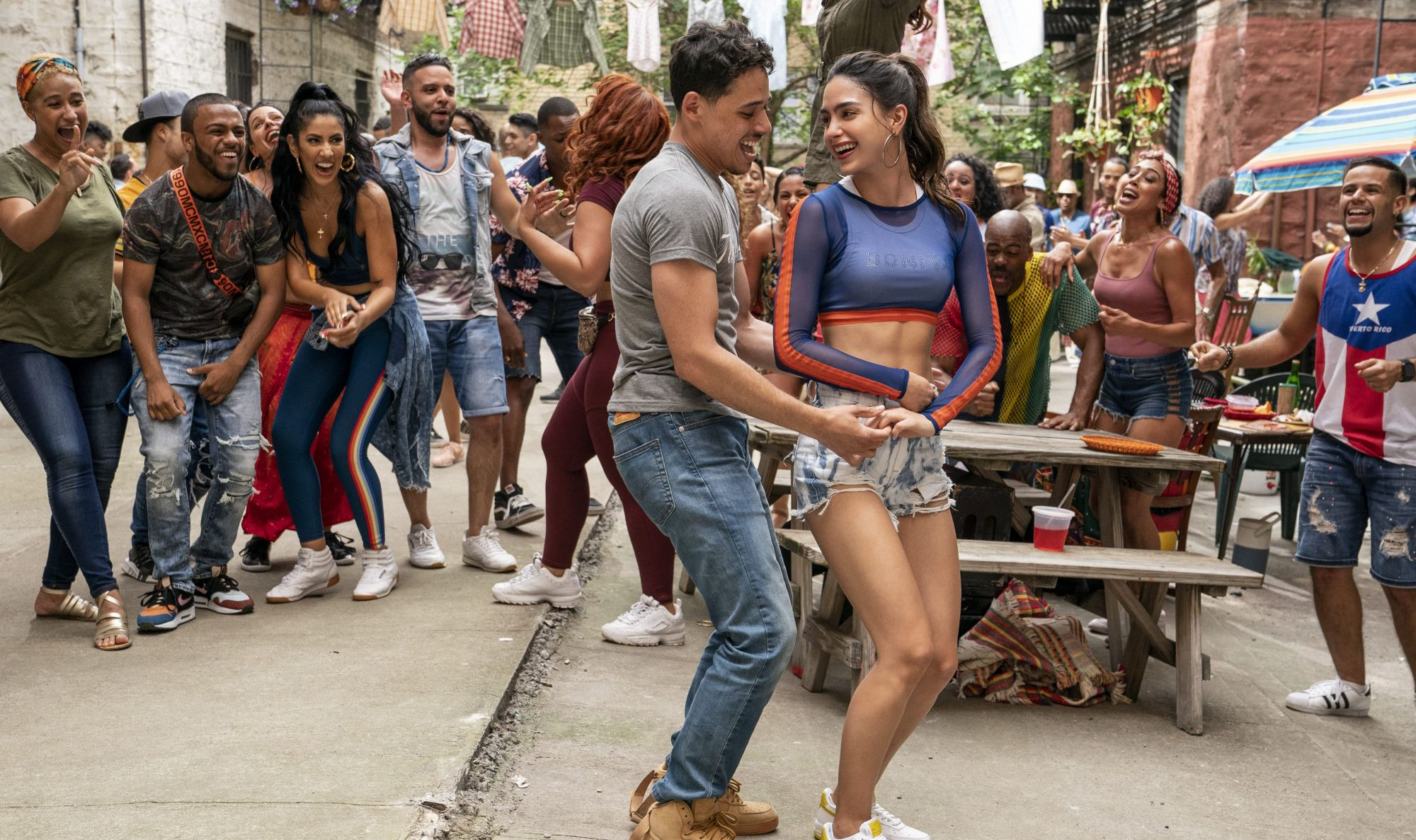 """Anthony Ramos and Melissa Barrera star as Usnavi de la Vega and Vanessa in the film adaption of """"In the Heights."""" (Photo: Warner Bros.)"""