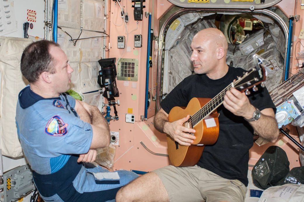European Space Agency astronaut Luca Parmitano, Expedition 36 flight engineer, plays a guitar in the Unity node of the International Space Station. Russian cosmonaut Alexander Misurkin, flight engineer, is at left. | Photo: NASA