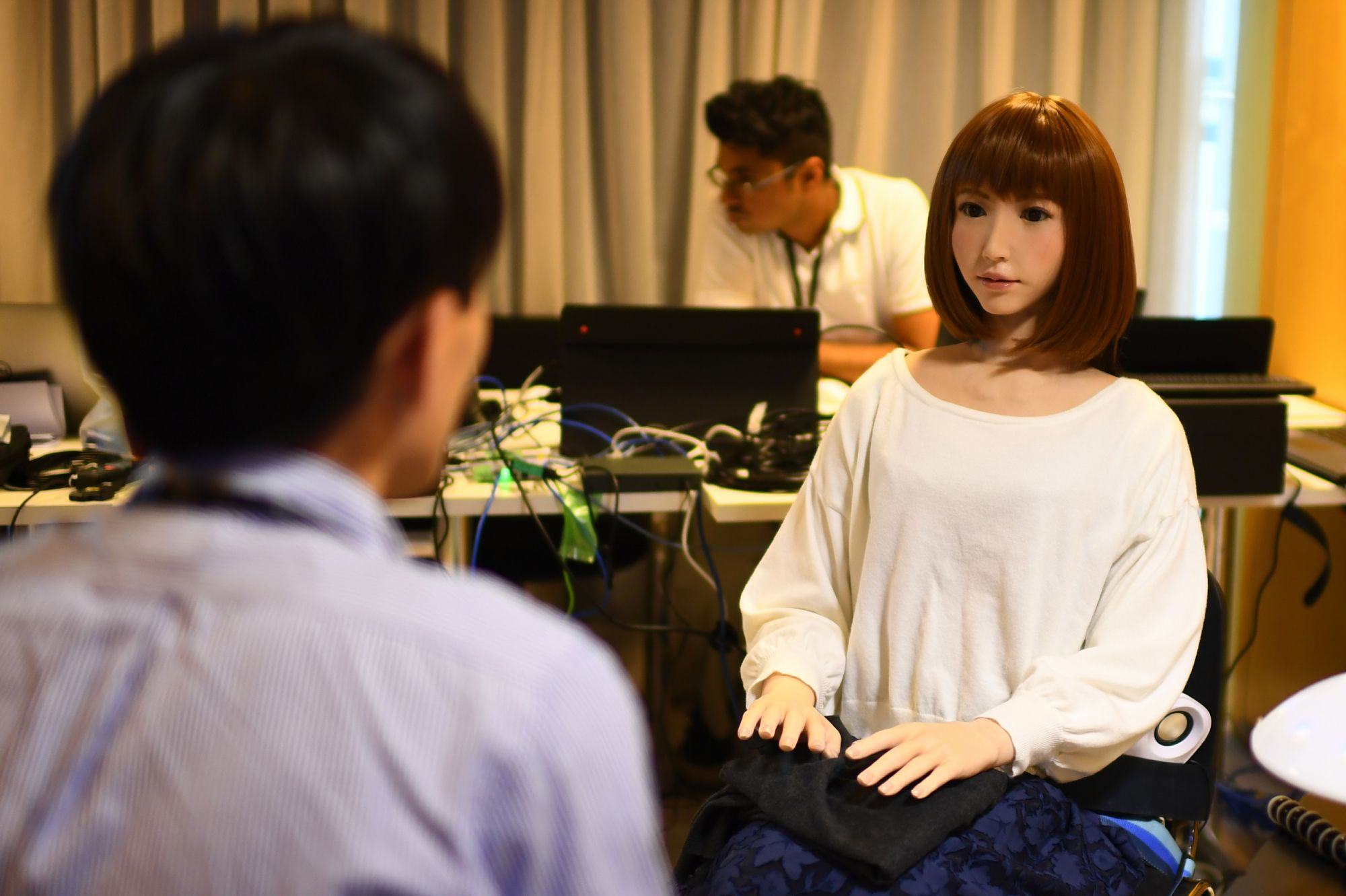 robot called Erica (R), created by Japan's Hiroshi Ishiguro Laboratories, conducts a job interview during its presentation at the IROS 2018 International Conference on Intelligent Robots on October 5, 2018 in Madrid.