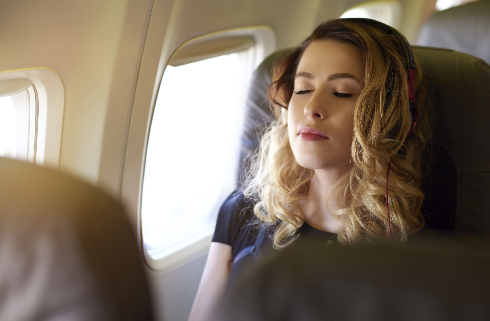7 Ways To Care For Your Skin On A Long-Haul Flight