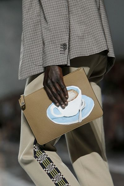 A standout zippered leather pouch featuring a watercolor effect coffee cup design from Fendi's covetable SS18 accessories range.