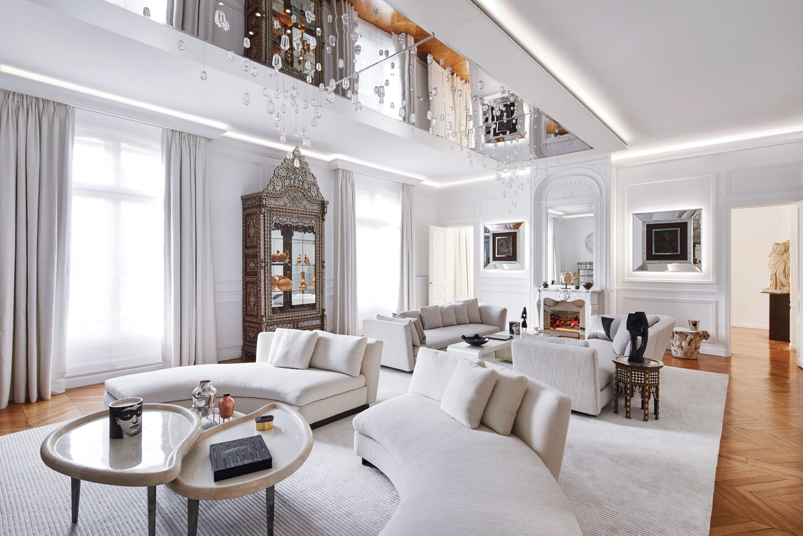 A light palette lets the art and antiques become the stars of the living area