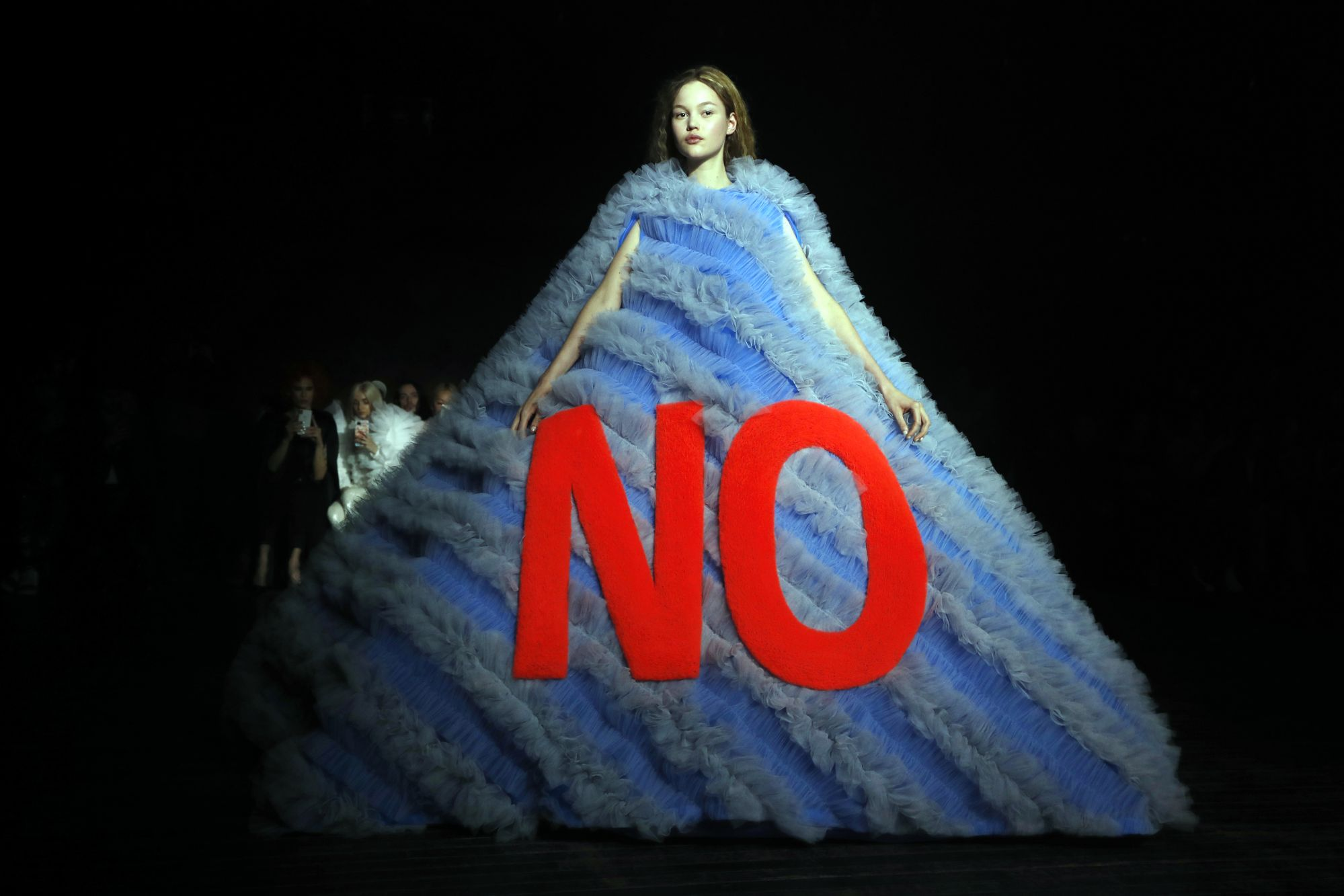 Among the many voluminous and imposing dresses by Viktor & Rolf, one outstandingly poetic creation took the form of a sublime pyramid emblazoned with the word 'No'