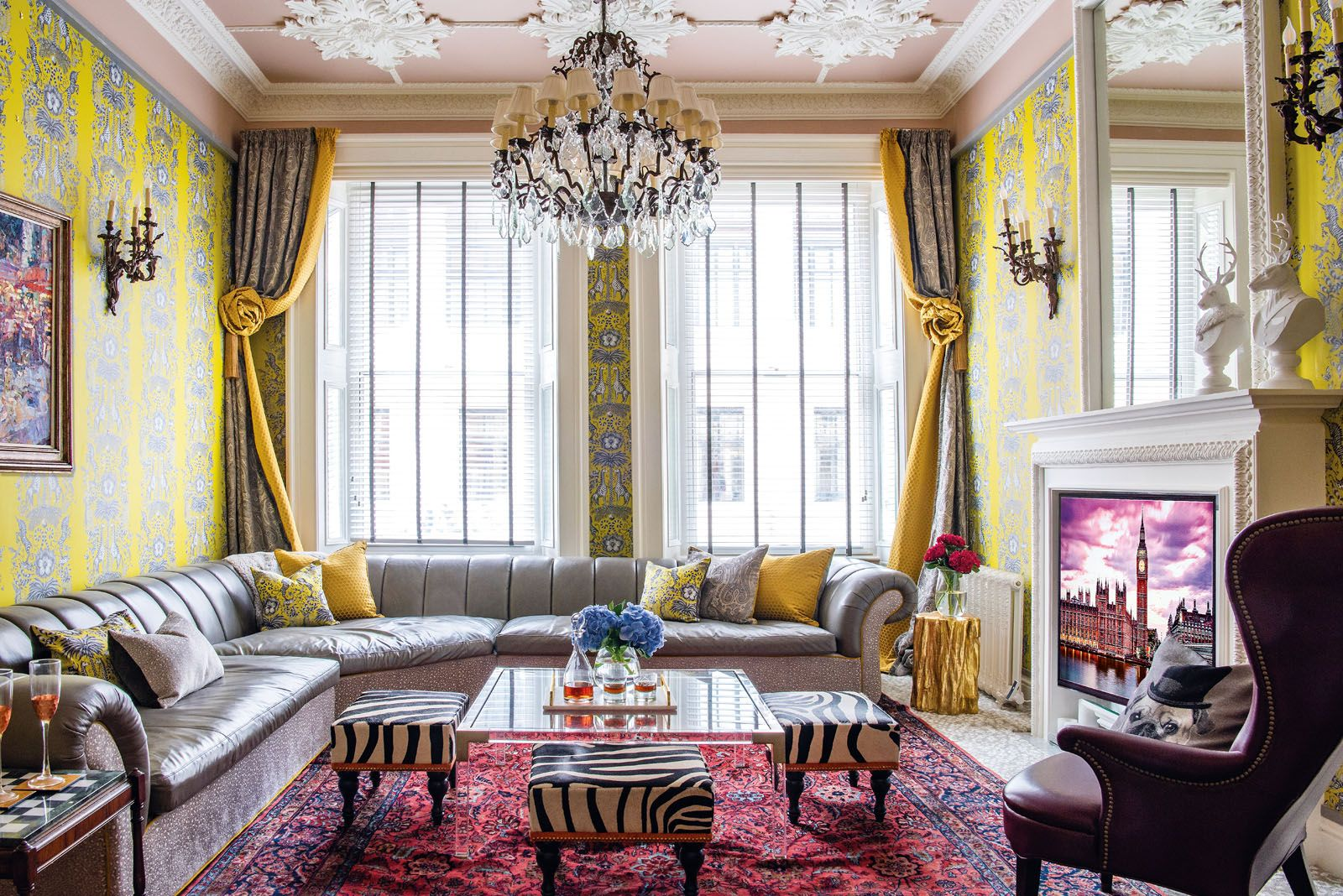 The Rococo rose plasterwork on the ceiling references the apartment's architectural heritage, while the spacious sectional sofa encourages family bonding in the living room. The yellow wallpaper was inspired by the work of British interior designer John Fowley