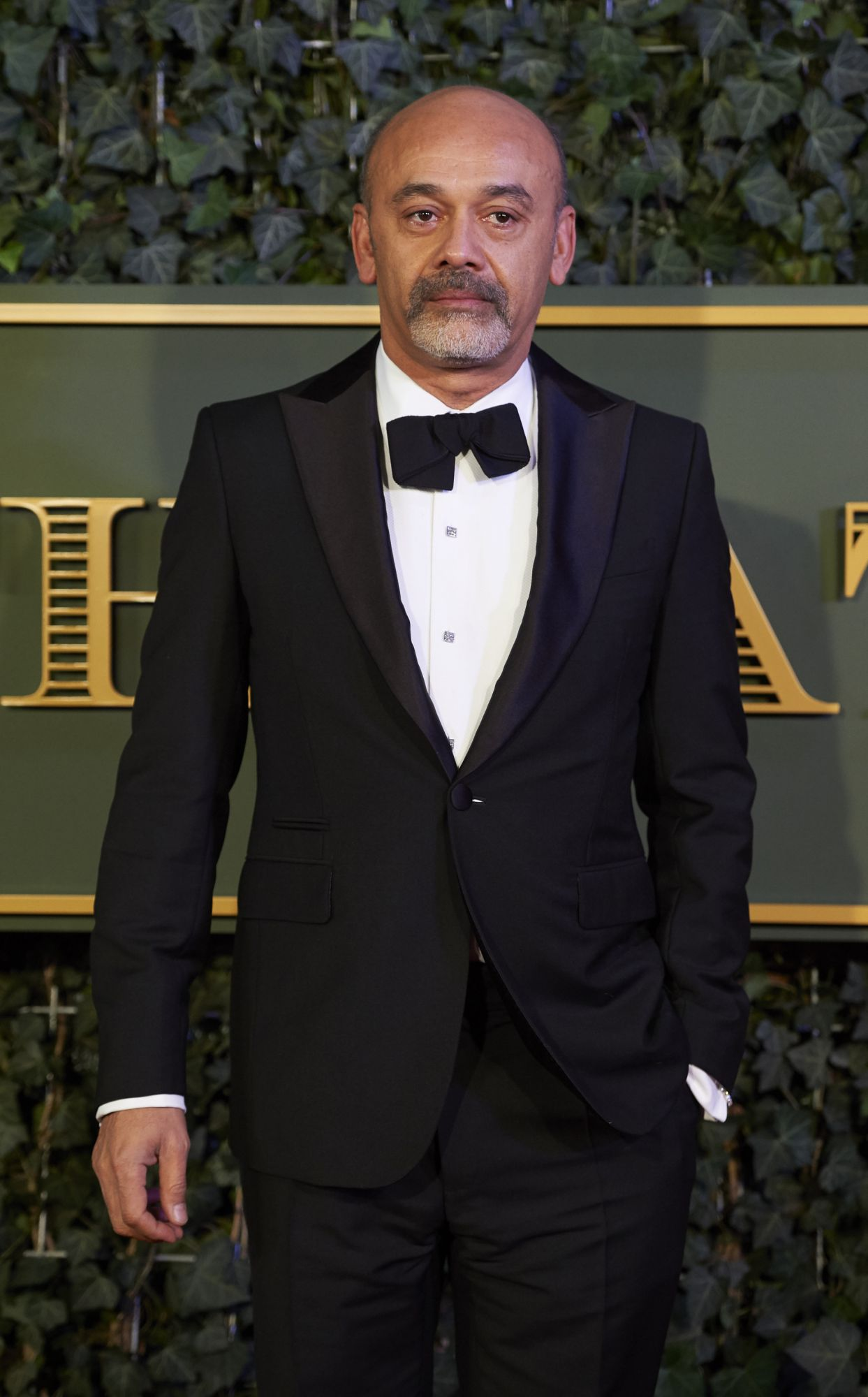 French luxury footwear and fashion designer Christian Louboutin poses on the red carpet as he attends the 61st London Evening Standard Theatre Awards 2015 in London on November 22, 2015. AFP PHOTO / NIKLAS HALLE'N / AFP PHOTO / NIKLAS HALLE'N