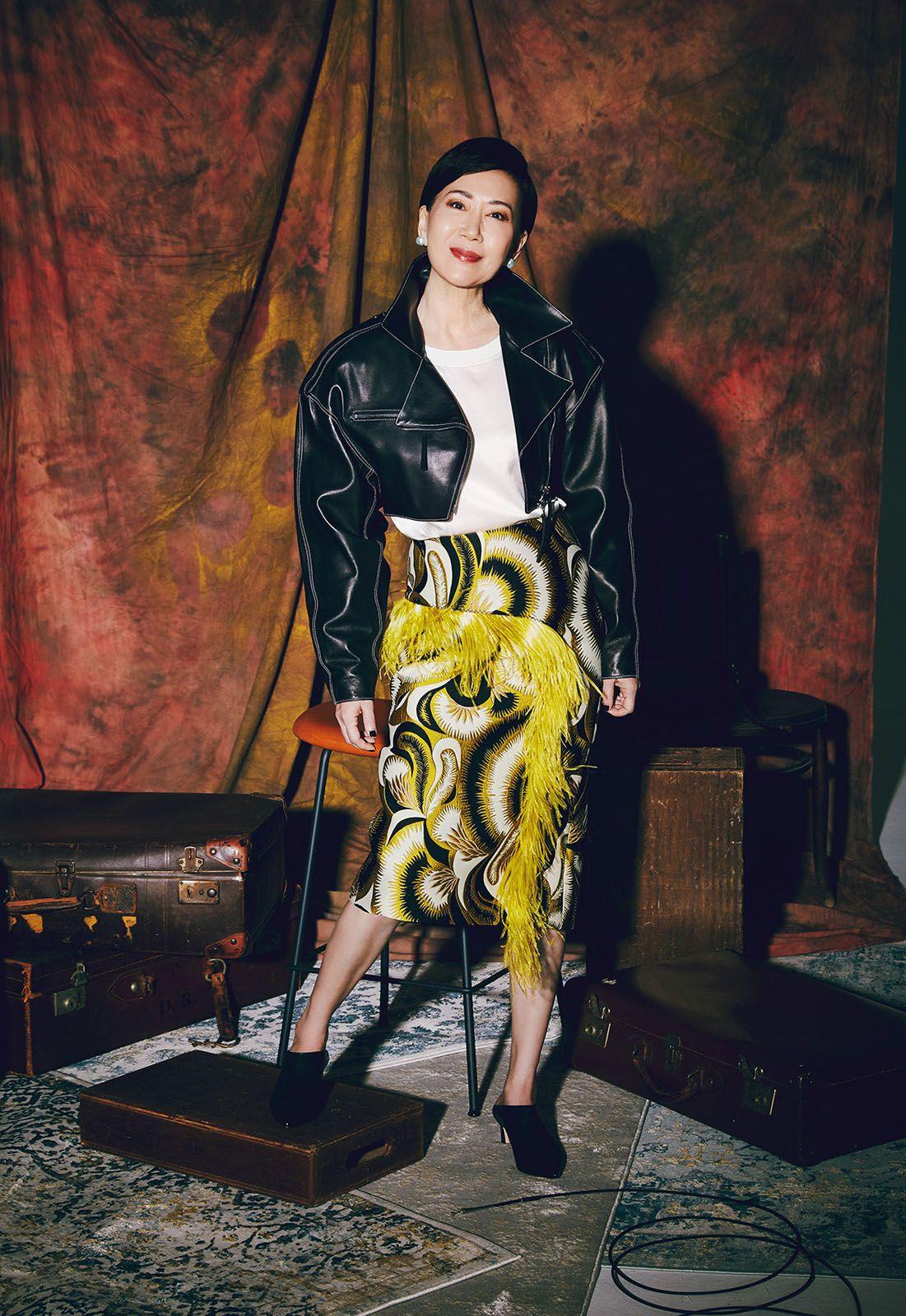 Nancy wears Marni jacket, Emporia Armani blouse, Dries Van Noten skirt, Stuart Weitzman heels and Papally earrings, all Nancy's own; crystal ear cuff by Fendi
