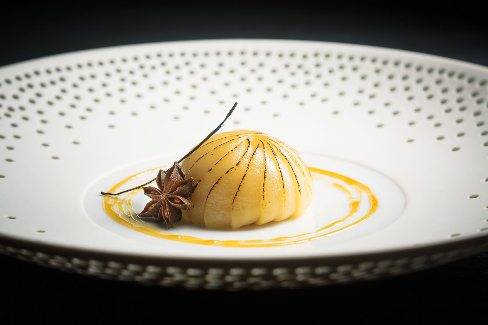Williams pear poached in an infusion of star anise and bourbon vanilla, and paired with light vanilla cream