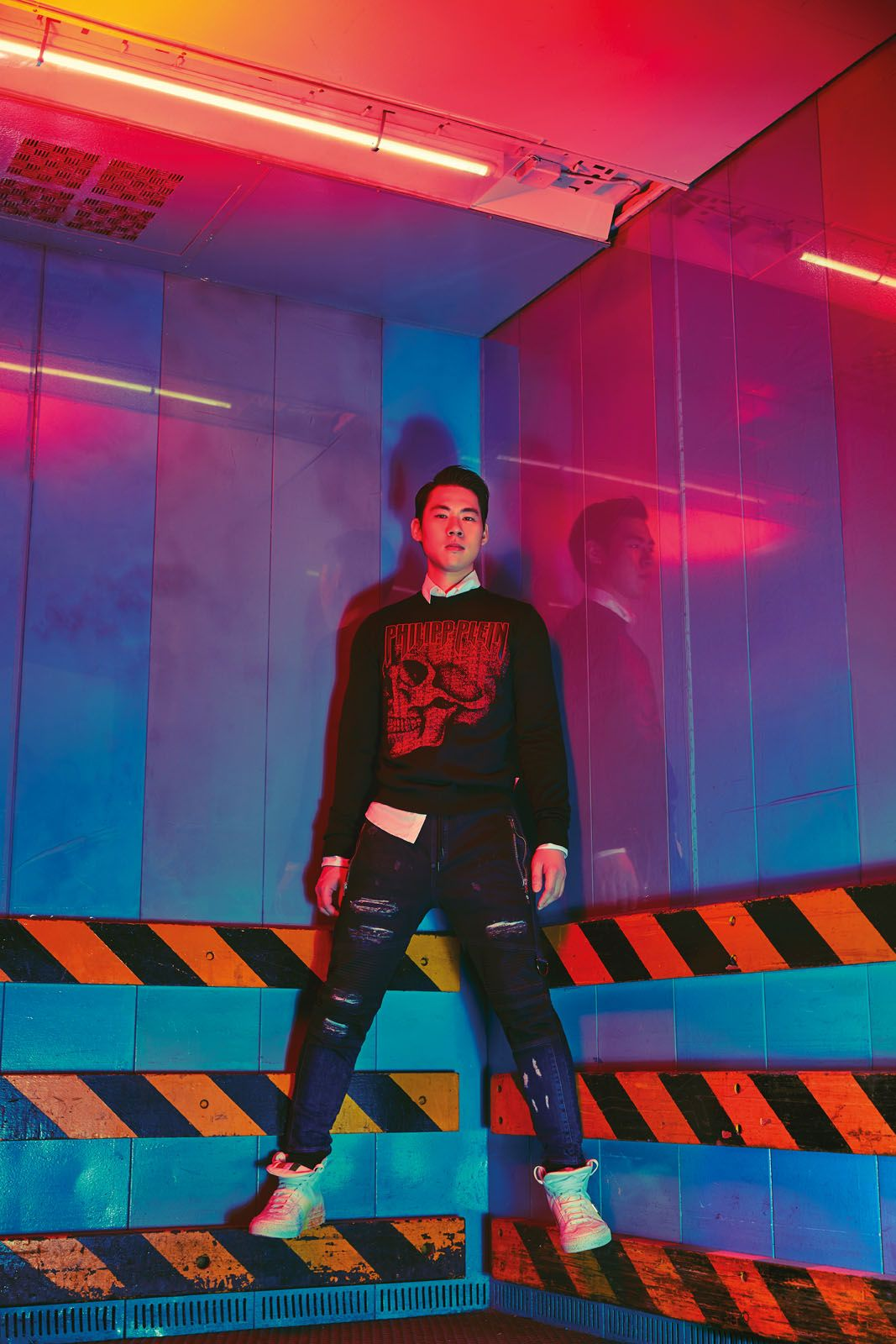 Ken wears printed cotton pullover, cotton shirt, distressed denim jeans and leather high-tops with paint splatter details