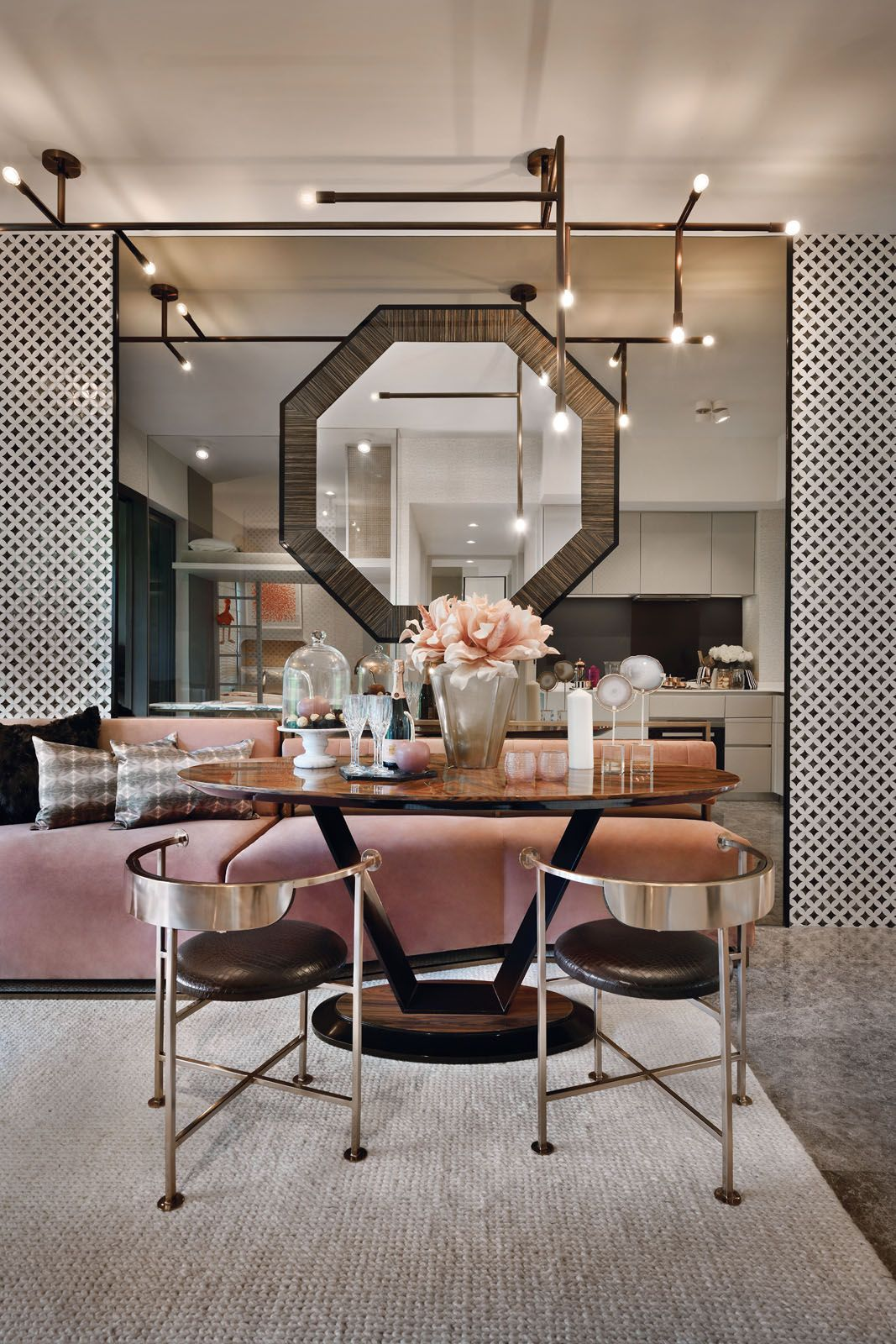 The blush pink sofa adds a feminine touch to the dining area at the Margaret Ville showflat
