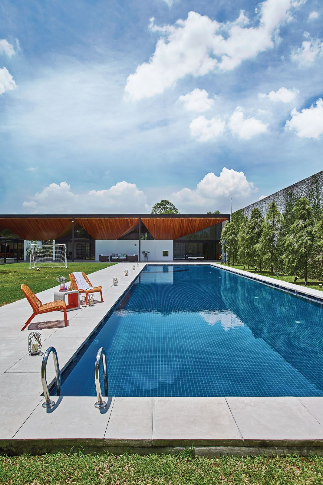The family enjoys playing football at the spacious field and swimming laps in the pool