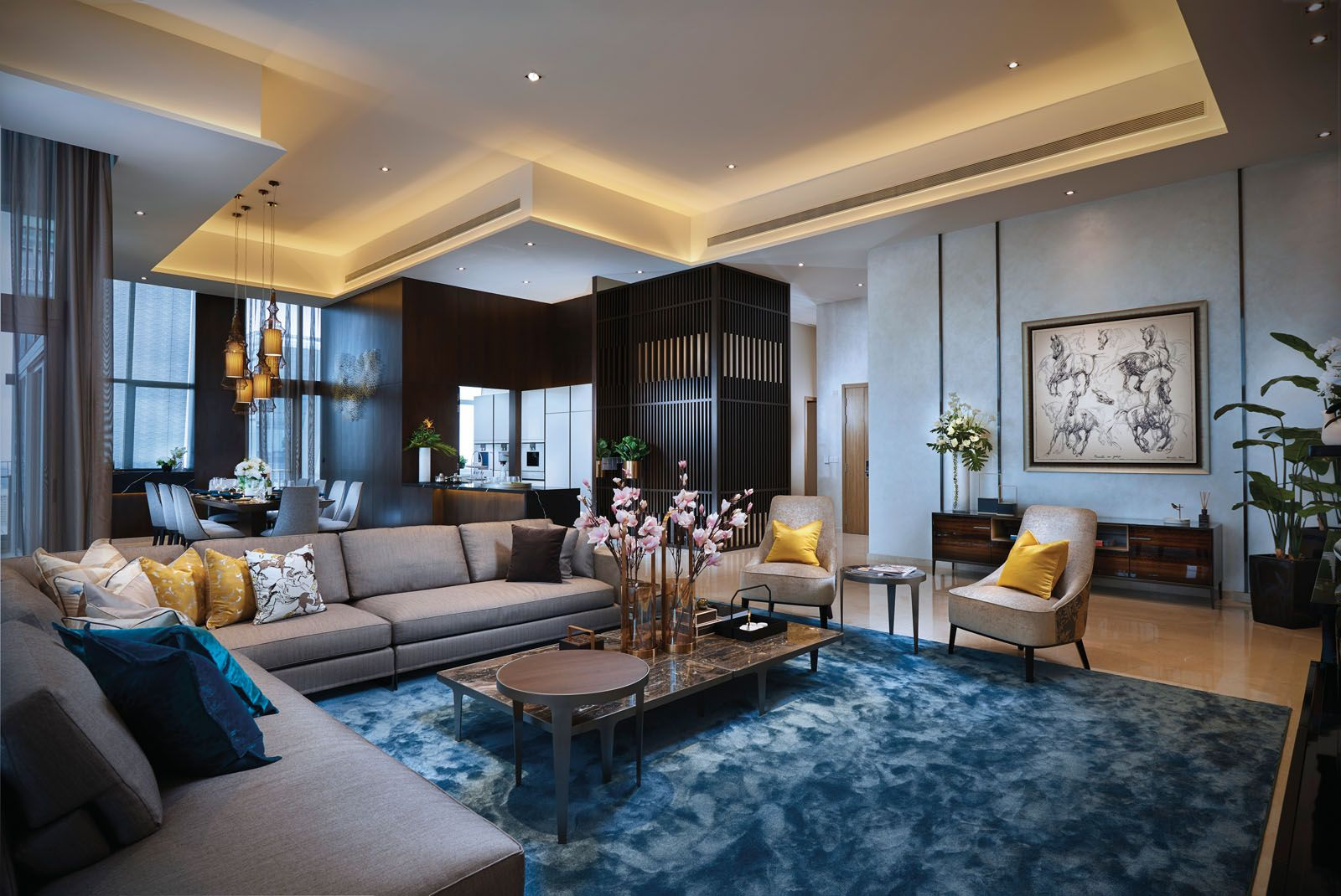 A lively mix of mustard and blue tones invigorate the living area of the penthouse