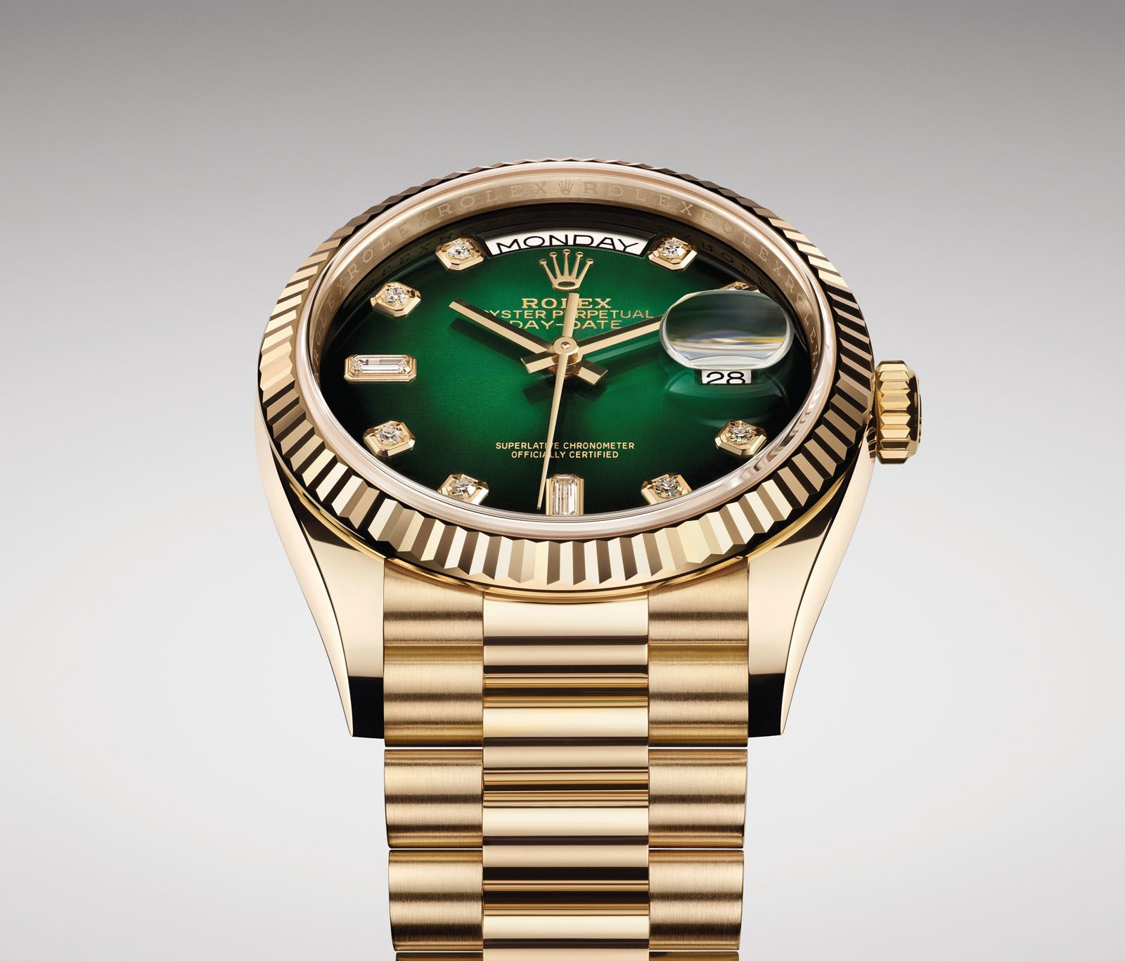 The 18K yellow gold variant of the Rolex Oyster Perpetual Day-Date 36 comes with a green ombre dial