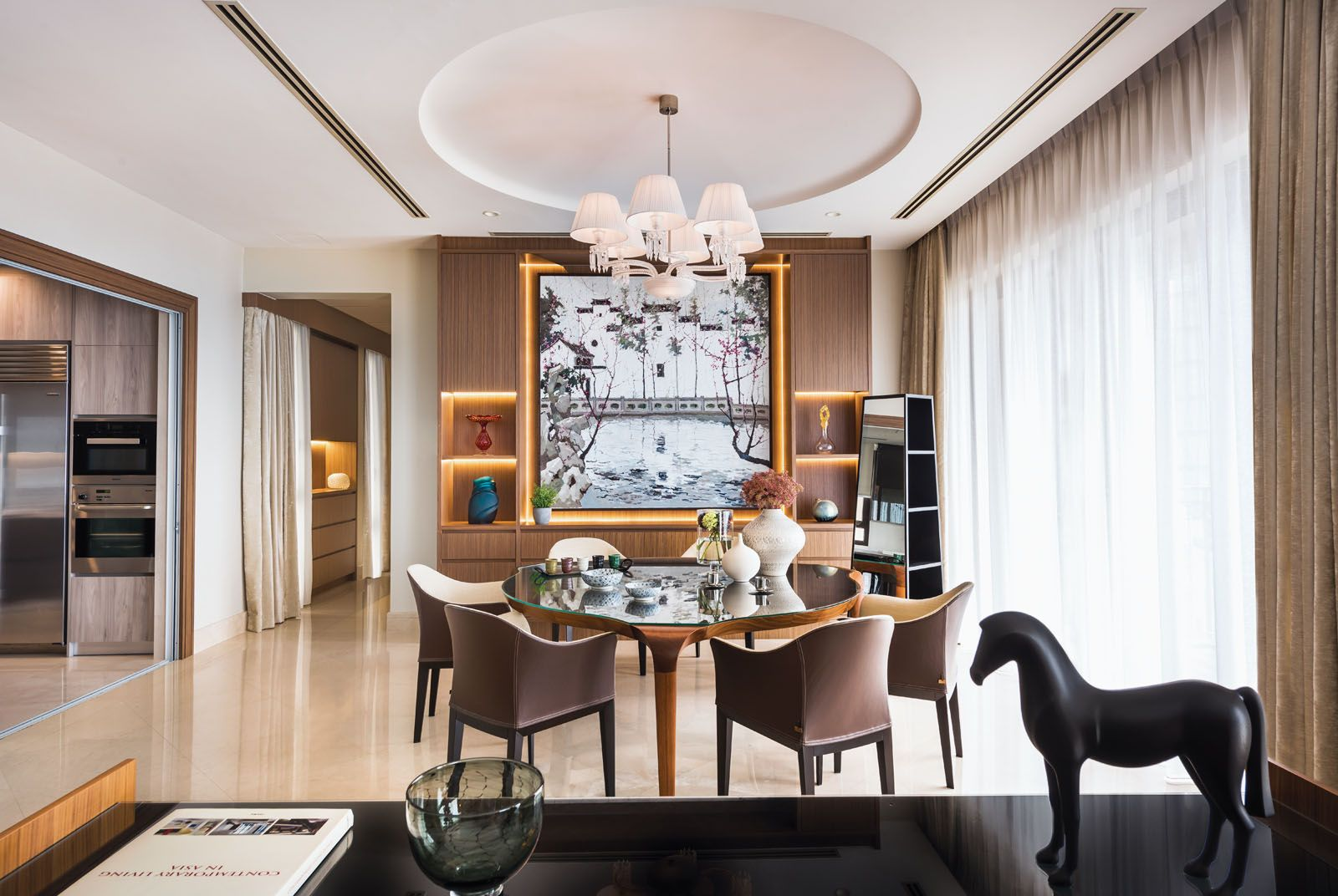 A Baccarat crystal chandelier floats above the dining area