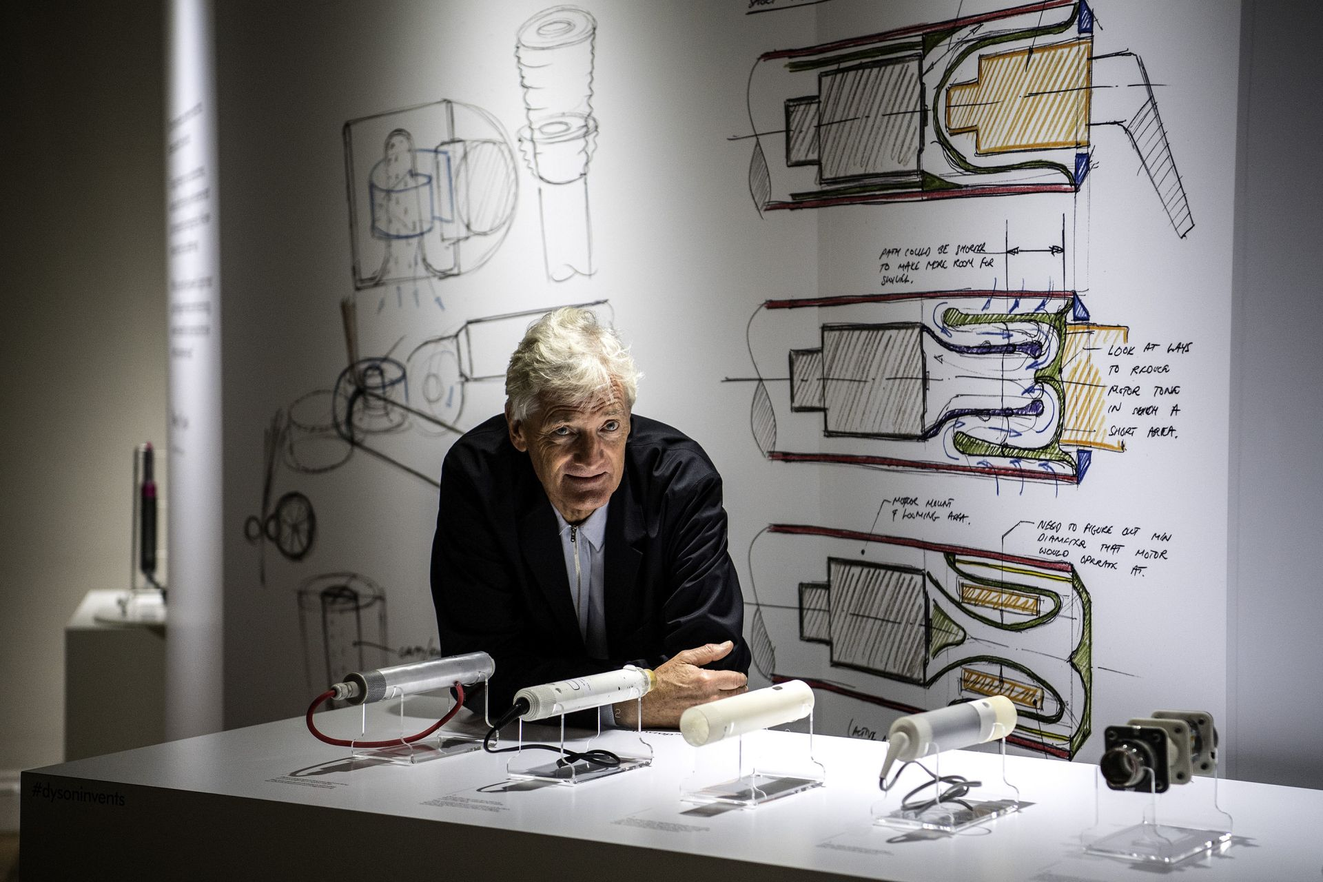 James Dyson poses with products during a photo session at a hotel in Paris (Image: Christophe Archambault/AFP)