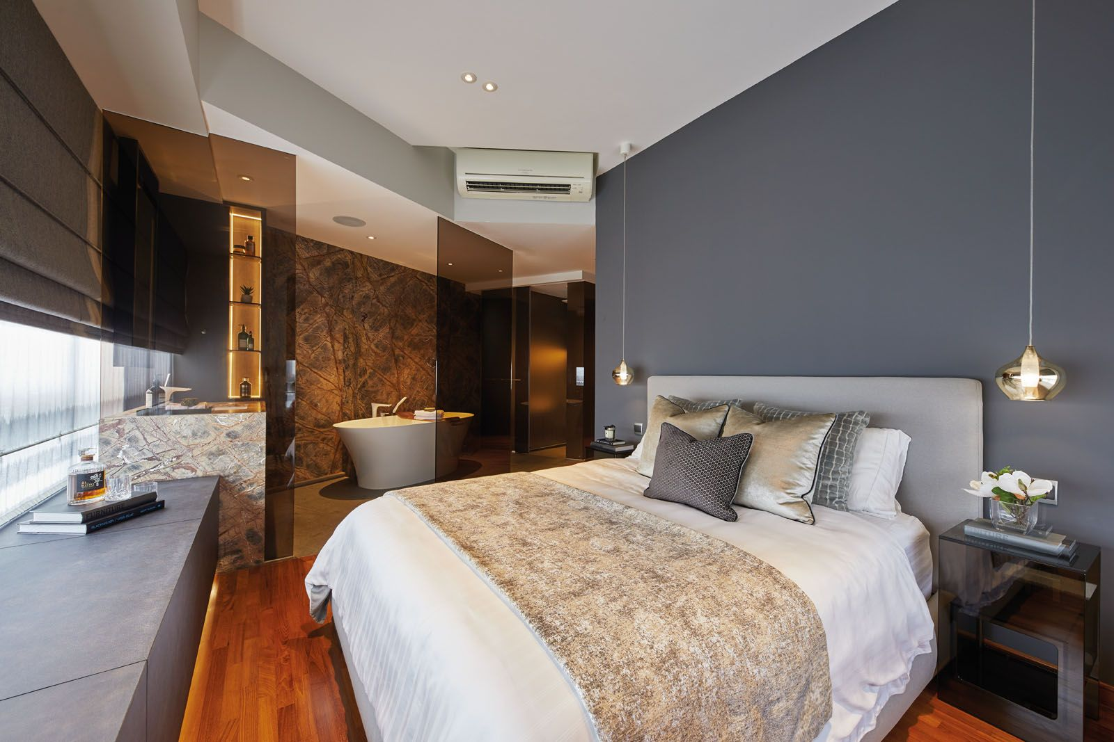 Champagne accents add a touch of glamour to the bedroom