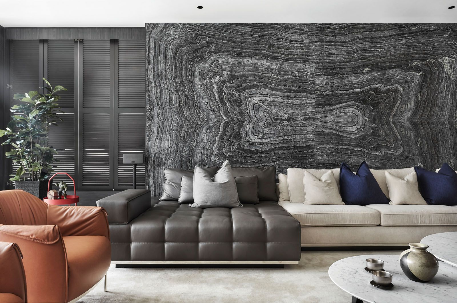 The heavy veins of the feature wall are the focal point of the living room