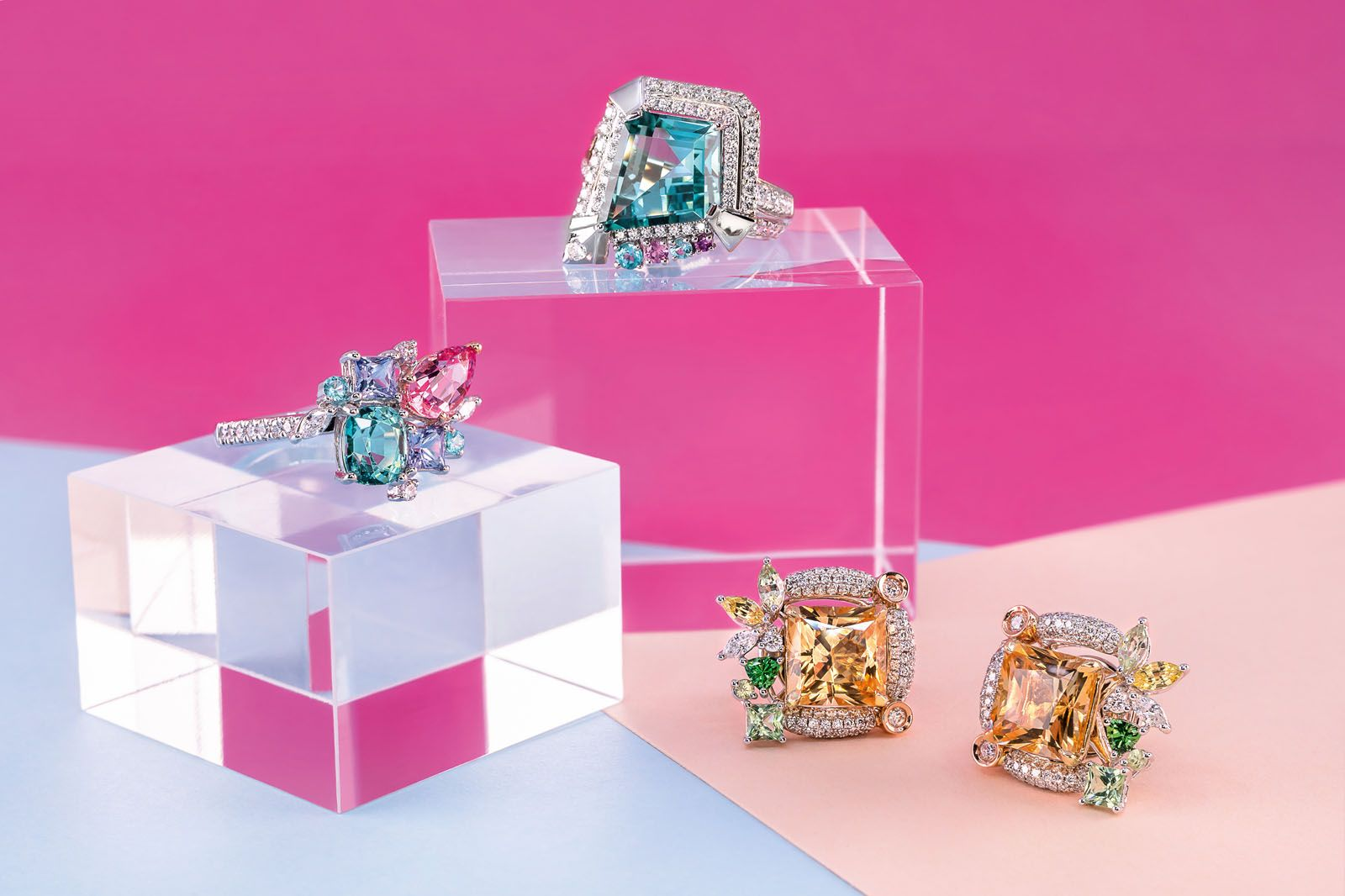 From left: Family ring in white gold with spinel, tourmaline, paraiba and tanzanite; cocktail ring in white gold with kite-cut lagoon tourmaline; earrings in white and rose gold (with removable earring jackets) with princess‑cut imperial topaz studs, tsavorites, yellow sapphires and diamonds