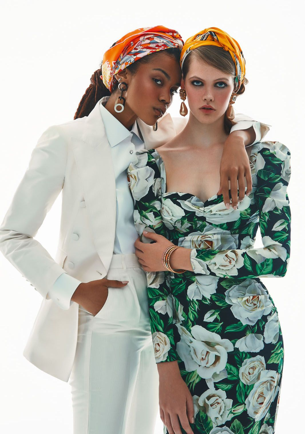 Silk jacket and trousers, and cotton shirt, all by Dolce & Gabbana; printed silk scarf and lacquered buffalo horn earrings, both by Hermès. Printed silk dress and brass earrings with pearls, both by Dolce & Gabbana; printed silk scarf and enamel bracelets, all by Hermès