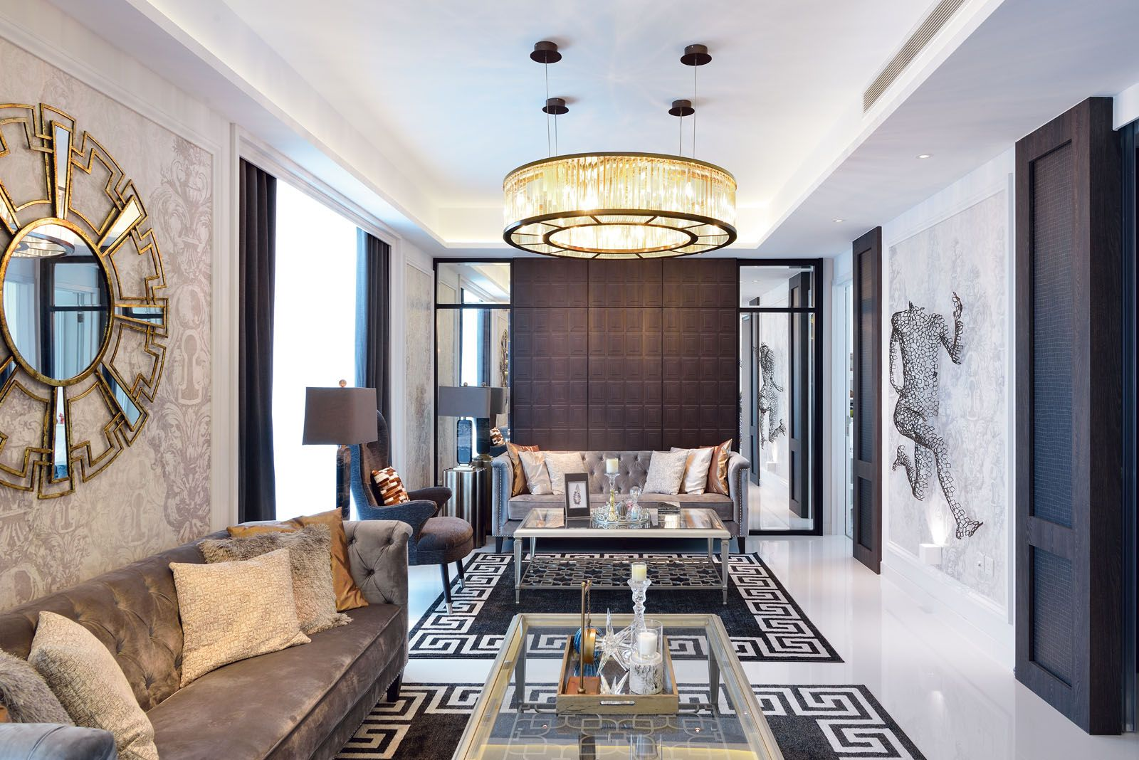 The crystal glass chandelier creates a focal point in the living room