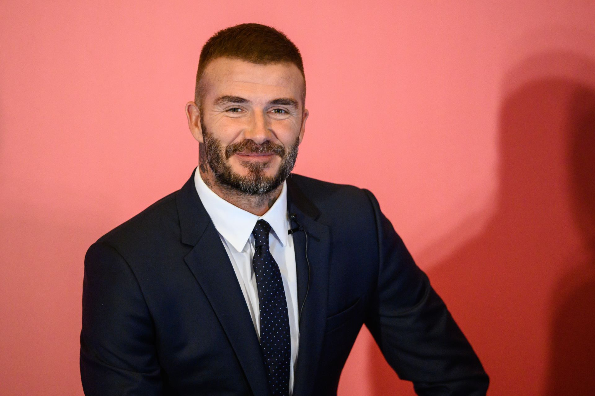 Former England footballer David Beckham speaks during a promotional event where he appeared as the global brand ambassador for insurance company AIA in Hong Kong on September 24, 2018. (Photo by Anthony WALLACE / AFP)