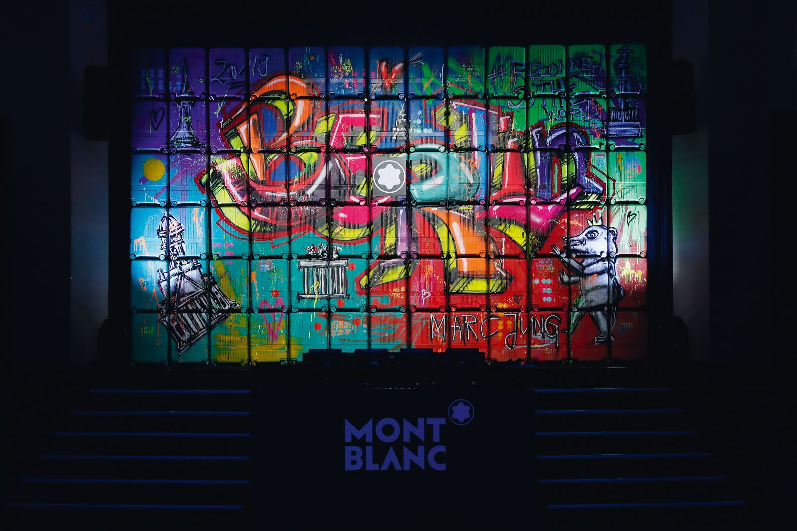 It took 50 cans of spray paint and 78 suitcases for German graffiti artist Marc Jung to create the brightly‑coloured trolley wall which was the centrepiece of Montblanc's Reconnect2theWorld event