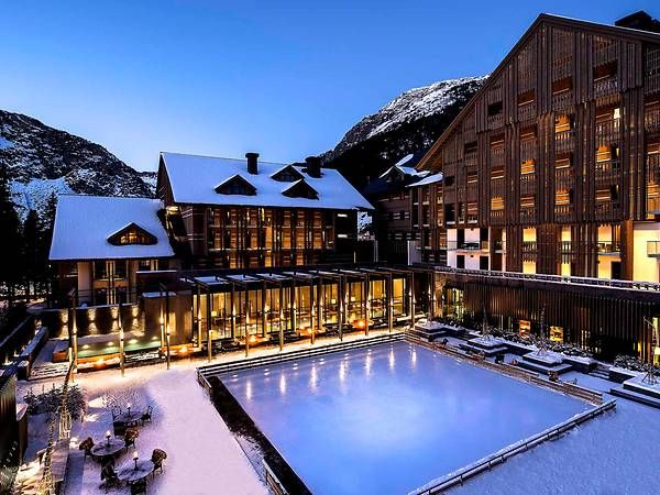 The Chedi Andermatt's Ice Rink on a winter evening