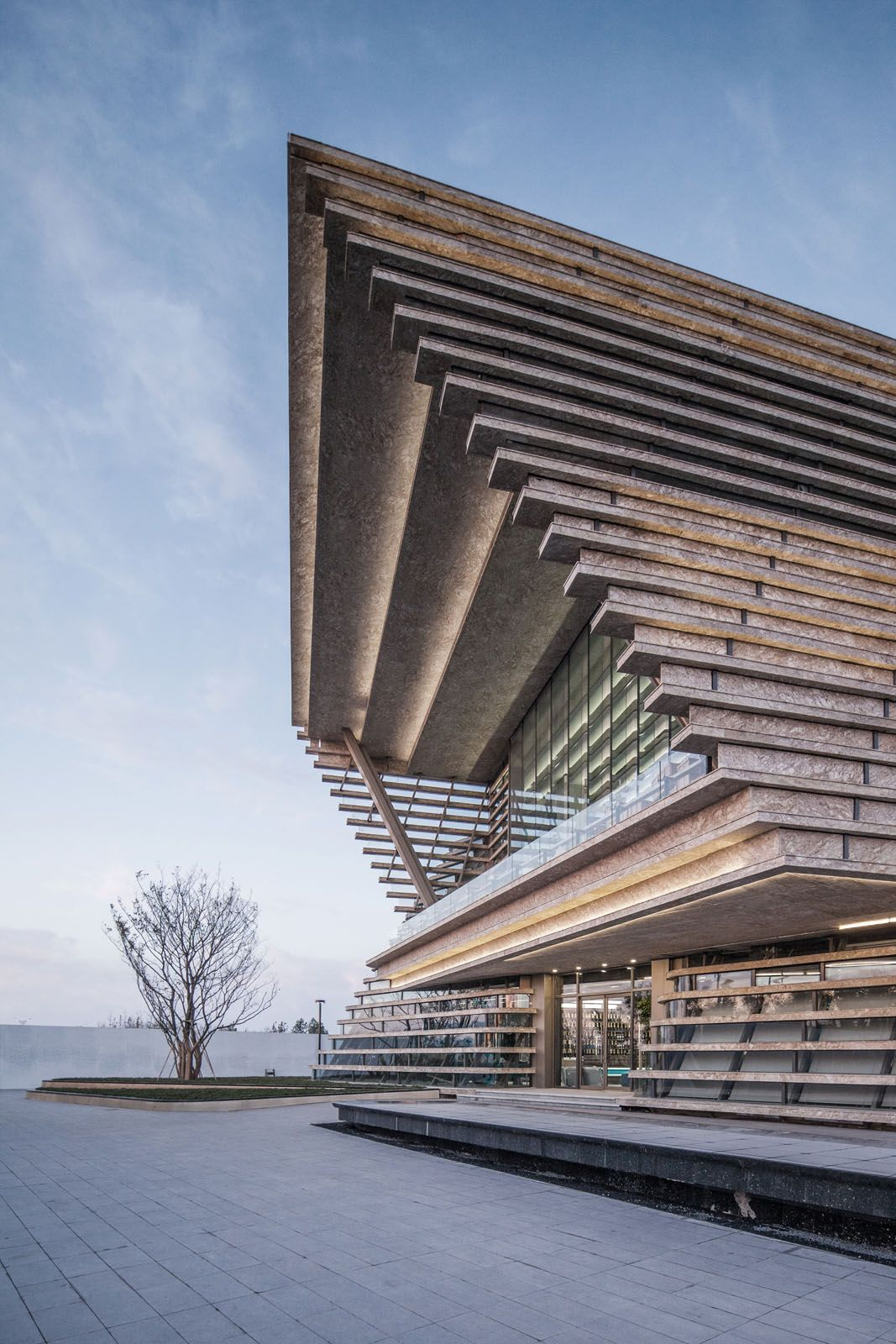 The Spiritual Bay Pavilion in Qingdao elegantly tilts 27 degrees to accord the upper levels spectacular sea views
