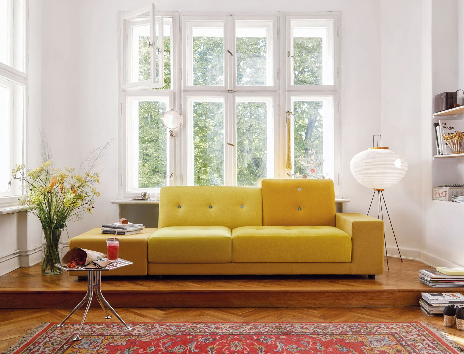 The Vitra Polder sofa features an asymmetrical form and varied colour combinations in shades of red, green, yellow and blue
