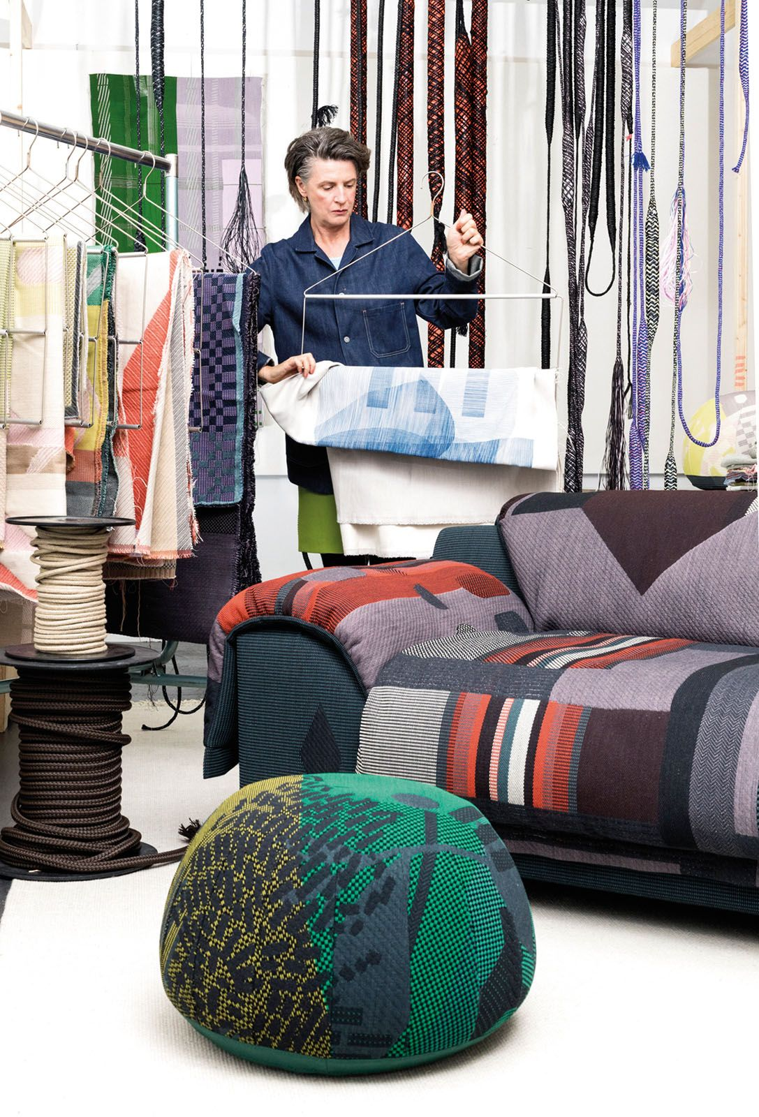 Dutch designer Hella Jongerius peruses the vibrant array of textiles used for the Vlinder sofa from Vitra