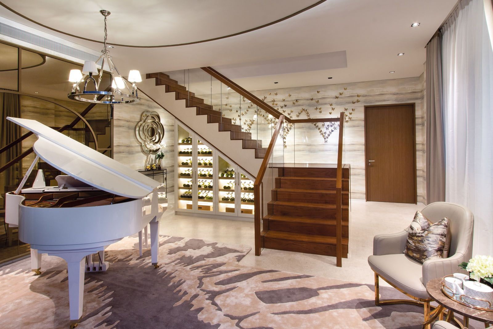 SuMisura installed illuminated shelves under the grand staircase to maximise the use of space in the lounge area