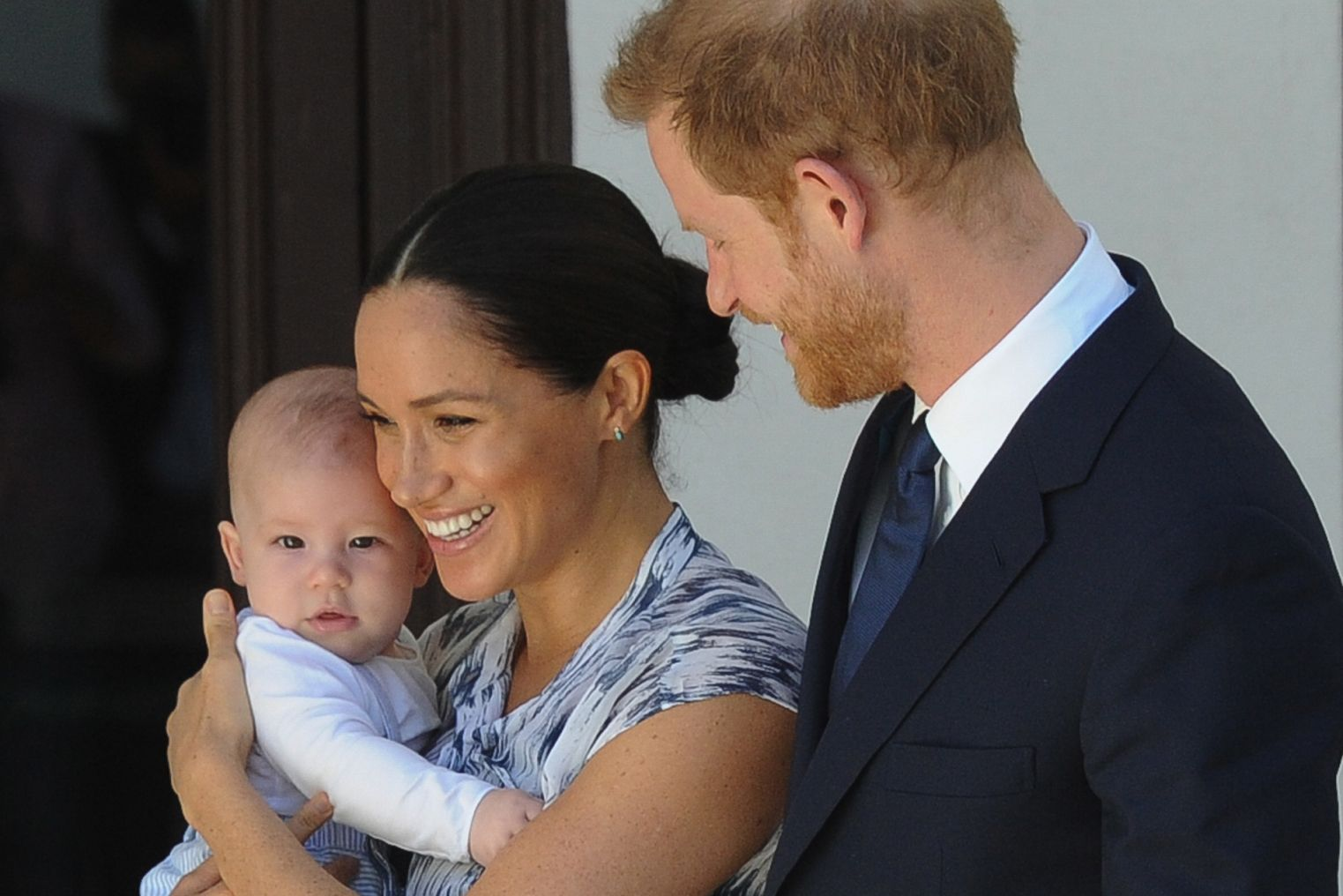 Britain's Duke and Duchess of Sussex, Prince Harry and his wife Meghan hold their baby son Archie as they meet with Archbishop Desmond Tutu and his wife (unseen) at the Tutu Legacy Foundation  in Cape Town on September 25, 2019. - The British royal couple are on a 10-day tour of southern Africa -- their first official visit as a family since their son Archie was born in May. (Photo by HENK KRUGER / POOL / AFP)