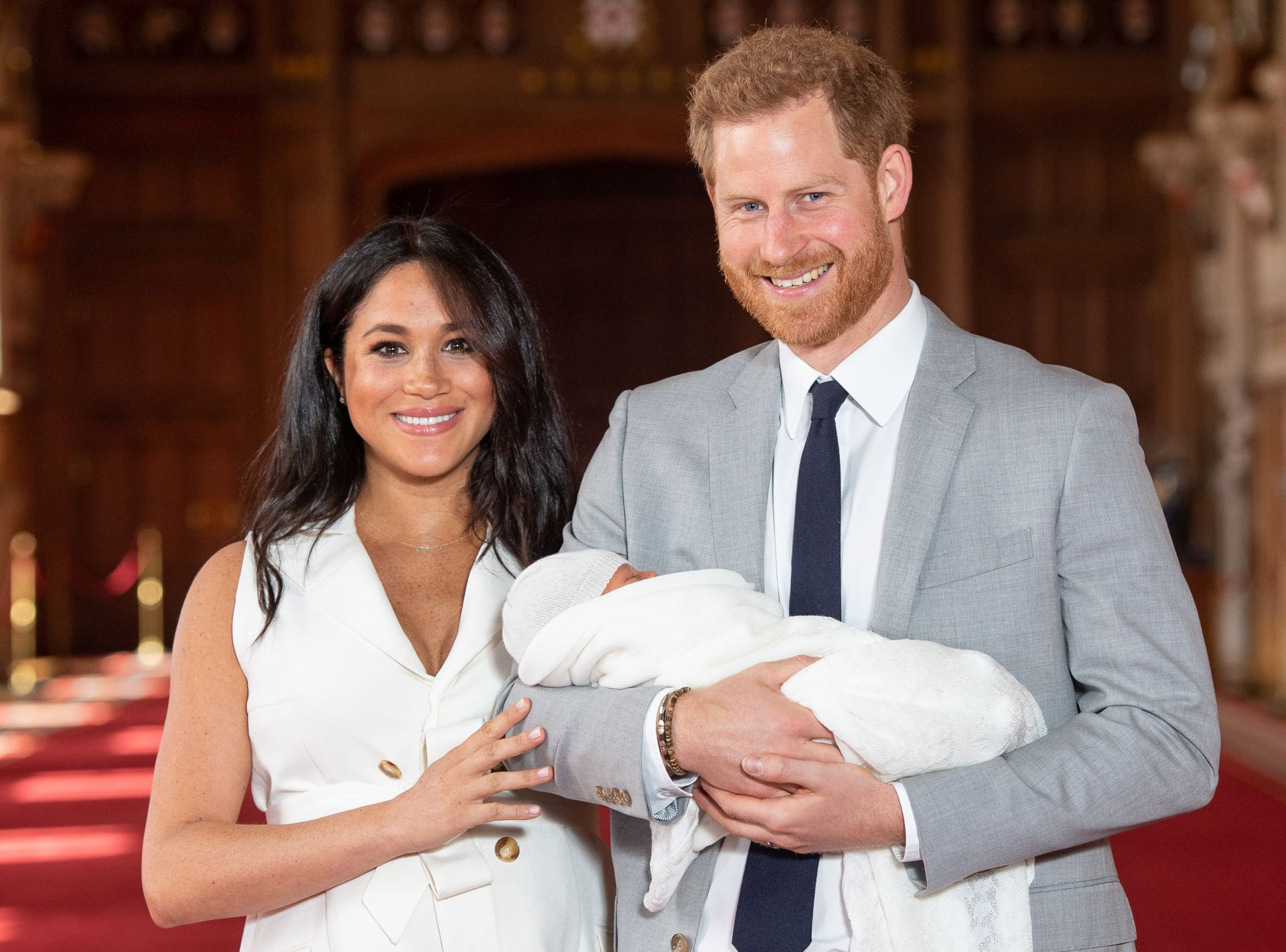 Britain's Prince Harry, Duke of Sussex (R), and his wife Meghan, Duchess of Sussex, pose for a photo with their newborn baby son in St George's Hall at Windsor Castle in Windsor, west of London on May 8, 2019. (Photo by Dominic Lipinski / POOL / AFP)