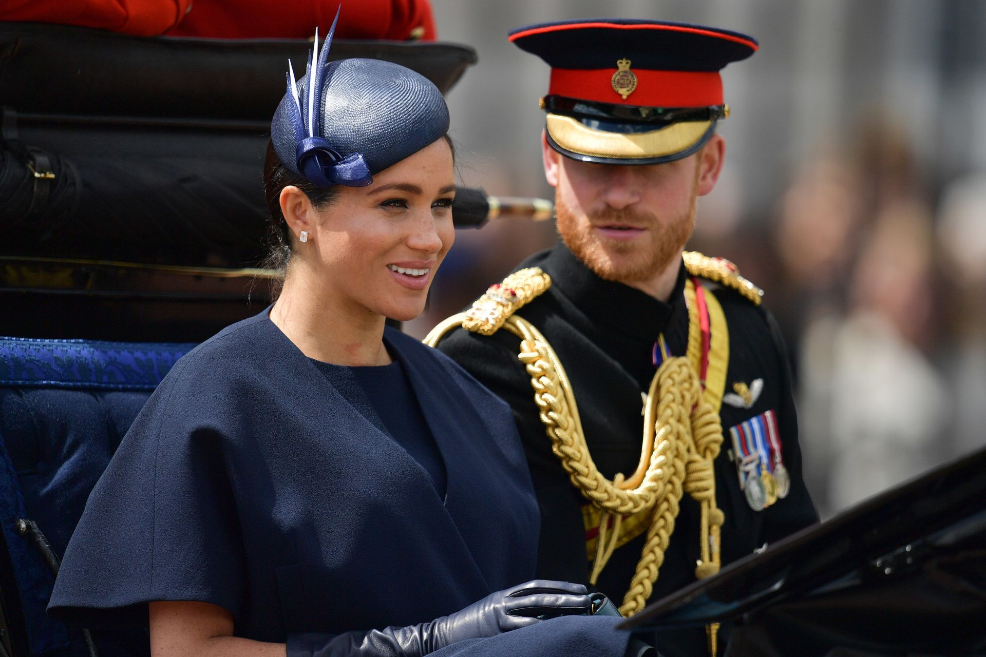 Britain's Meghan, Duchess of Sussex (L) and Britain's Prince Harry, Duke of Sussex (R) return to Buckingham Palace after the Queen's Birthday Parade, 'Trooping the Colour', in London on June 8, 2019. - The ceremony of Trooping the Colour is believed to have first been performed during the reign of King Charles II. Since 1748, the Trooping of the Colour has marked the official birthday of the British Sovereign. Over 1400 parading soldiers, almost 300 horses and 400 musicians take part in the event. (Photo by
