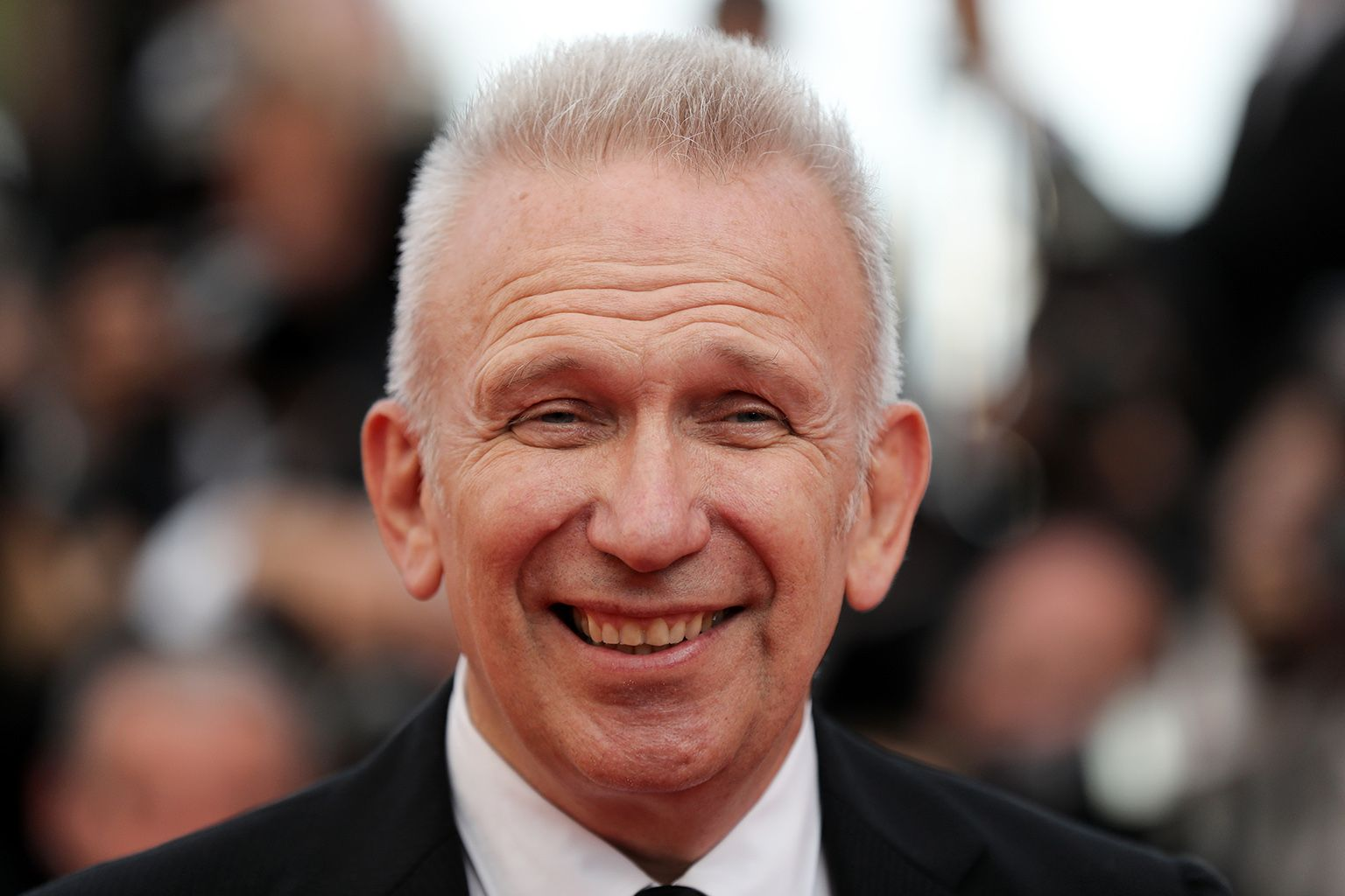 "(FILES) This file photo taken on May 23, 2017 shows French fashion designer Jean-Paul Gaultier arriving for the ""70th Anniversary"" ceremony of the Cannes Film Festival in Cannes, southern France. In October 2018, Jean Paul Gaultier, will sign and stage at the Folies Bergeres a  show evoking his career through half a century of pop culture and fashion, he told AFP on November 8, 2017. / AFP PHOTO / Valery HACHE"