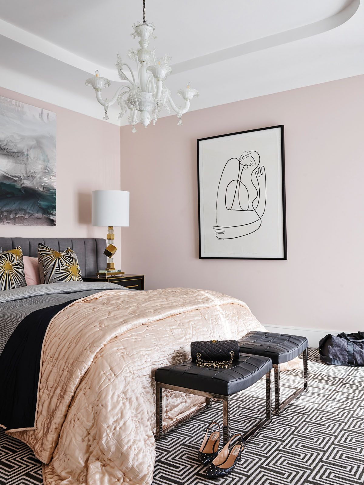 The vintage Murano glass chandelier in the bedroom is a whimsical touch