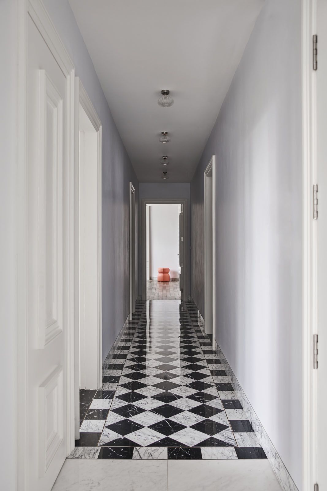 The corridor features a striking checkerboard pattern