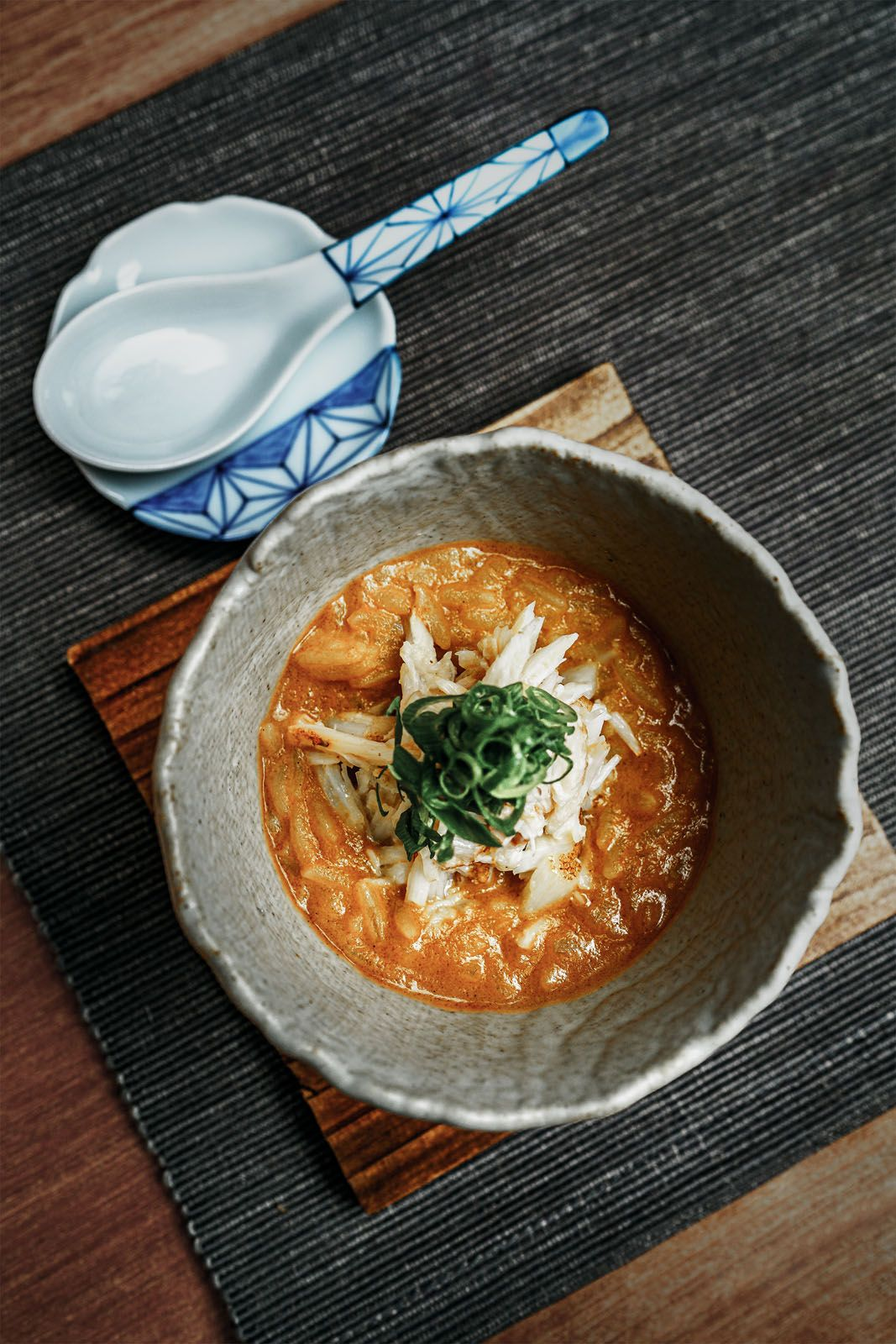 Inspired by a local classic and Japanese rice soup, Gan Ming Kiat's crab porridge features Sri Lankan mud crab meat with his take on the chilli crab sauce made from scratch