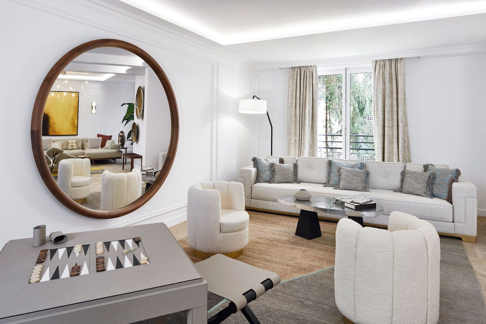 A round mirror frames the colourful tableau of furnishings in the primary living room