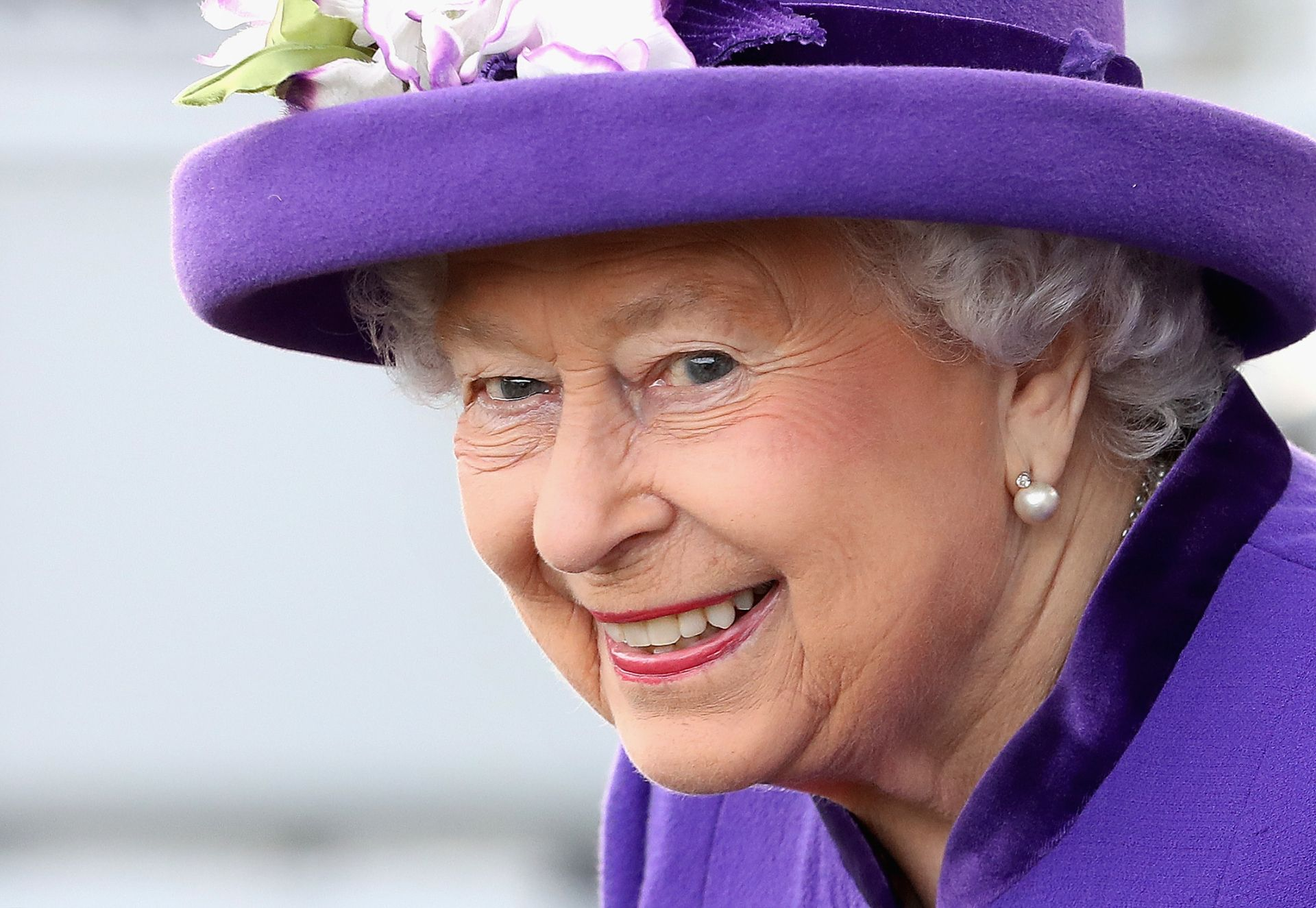 (FILES) In this file photo taken on December 07, 2017, Britain's Queen Elizabeth II attends the Commissioning Ceremony for the Royal Navy aircraft carrier HMS Queen Elizabeth at HM Naval Base in Portsmouth, southern England . Queen Elizabeth II is to mark her 92nd birthday on April 21, 2018 with traditional gun salutes and a Commonwealth-themed charity concert featuring Tom Jones, Kylie and Shaggy. / AFP PHOTO / POOL / Chris Jackson