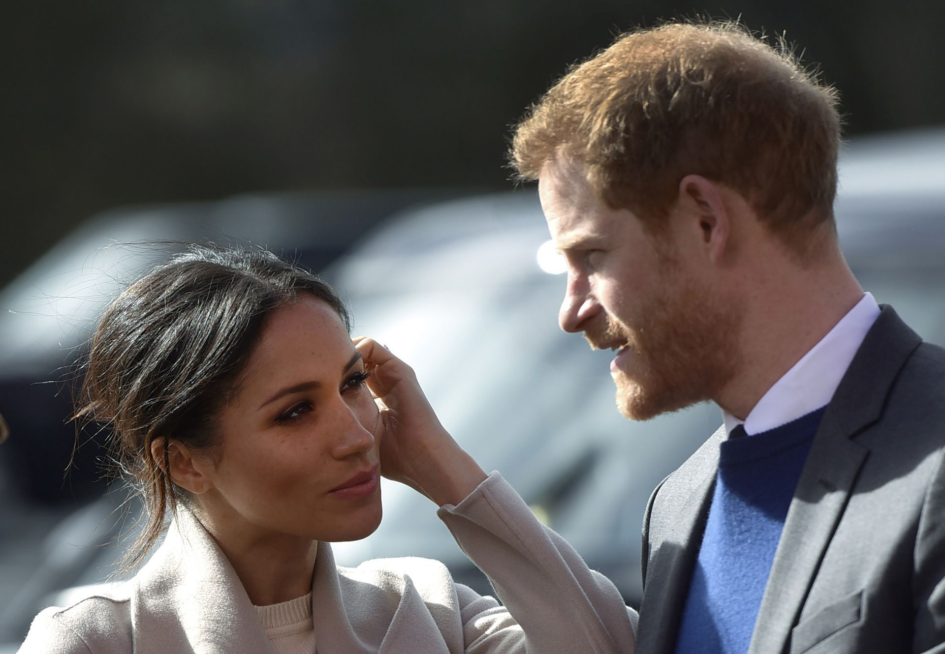Britain's Prince Harry and US actress and fiancee of Britain's Prince Harry Meghan Markle arrive at the Eikon Centre in Lisburn, on March 23, 2018, to attend an event to mark the second year of youth-led peace-building initiative Amazing the Space.  / AFP PHOTO / Mark MARLOW